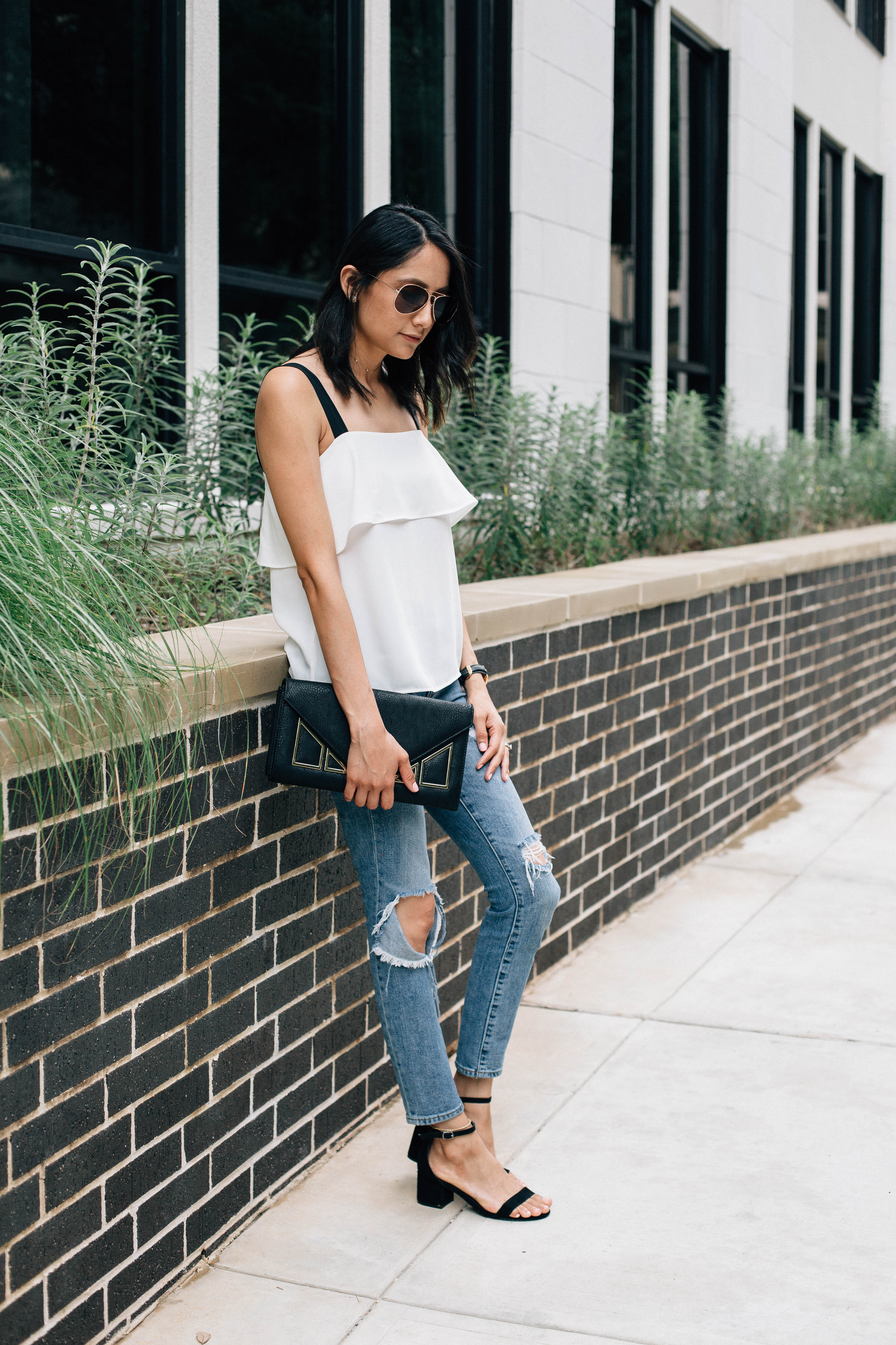 Lilly Beltran of Daily Craving fashion blog in an H&M top with black straps