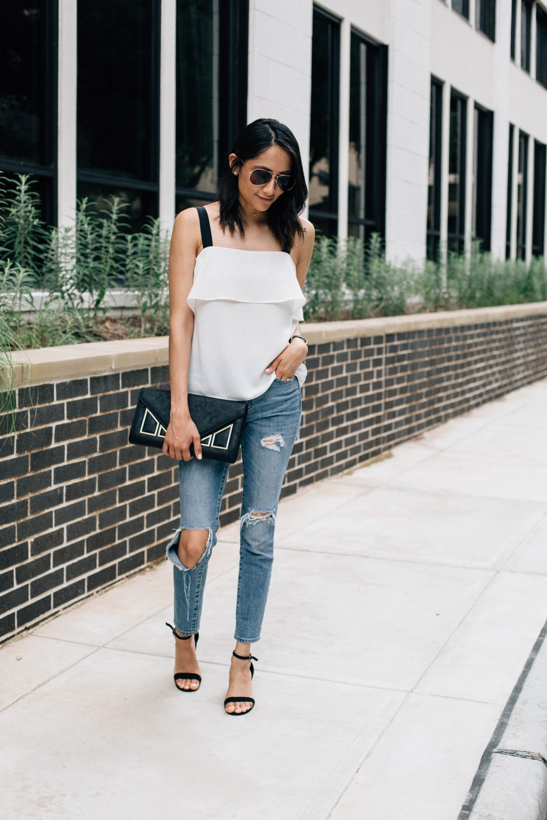 Fashion blogger Lilly Beltran of Daily Craving wearing a tiered top and ripped jeans