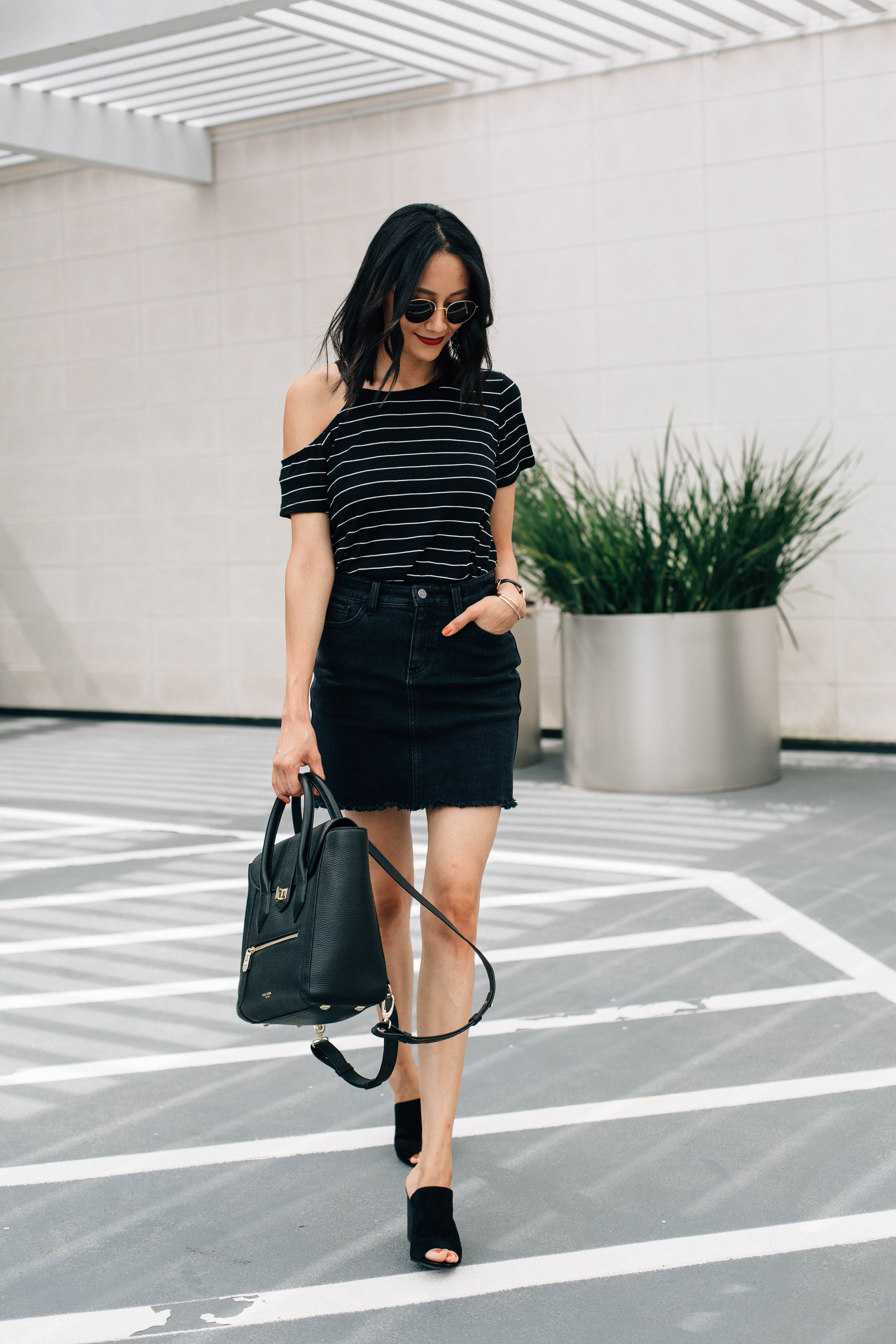 Lifestyle blogger Lilly Beltran wearing a striped basic tee a black denim skirt and suede mules