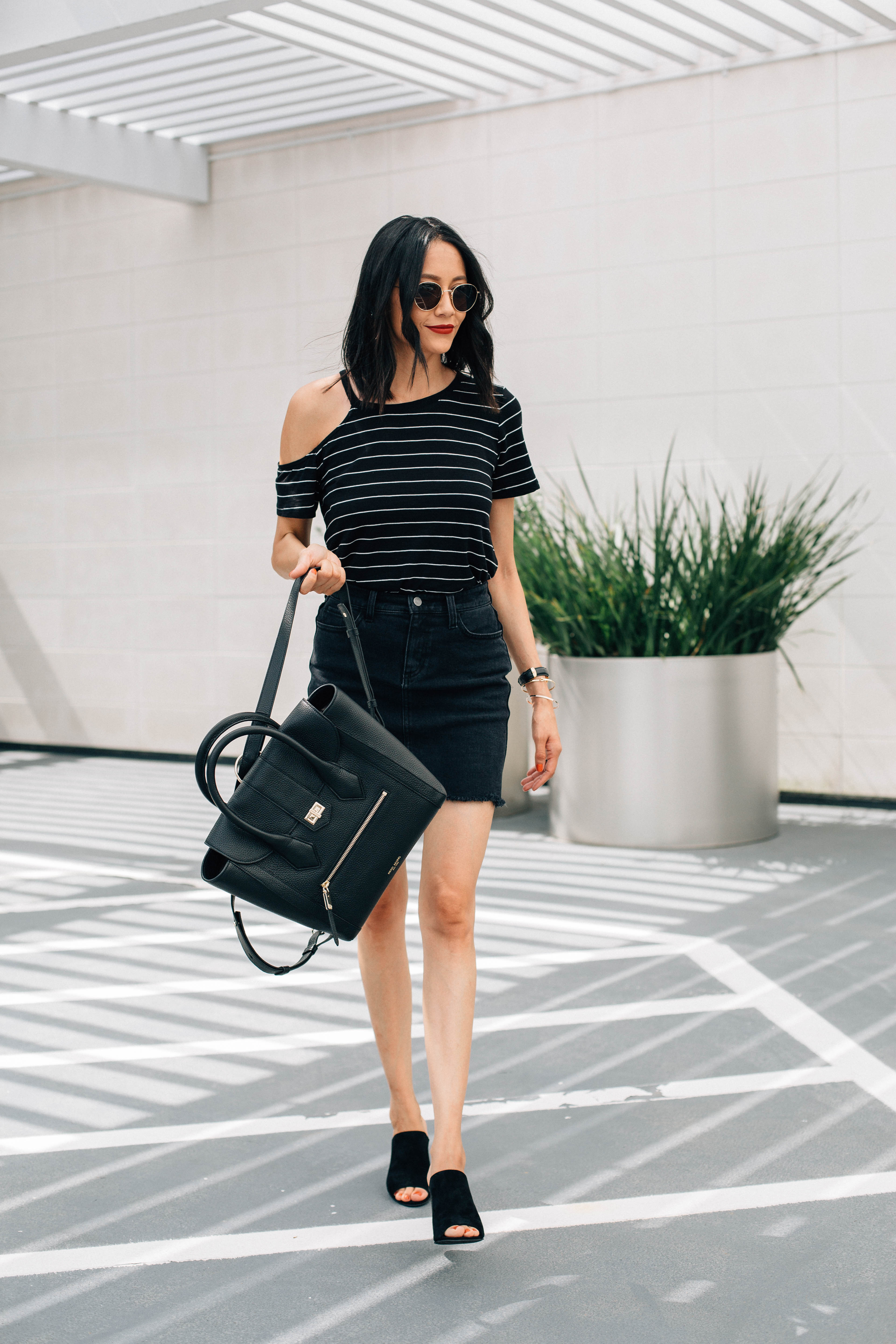 Lilly Beltran of Daily Craving blog wearing a chic look with suede mules and a cold shoulder tee