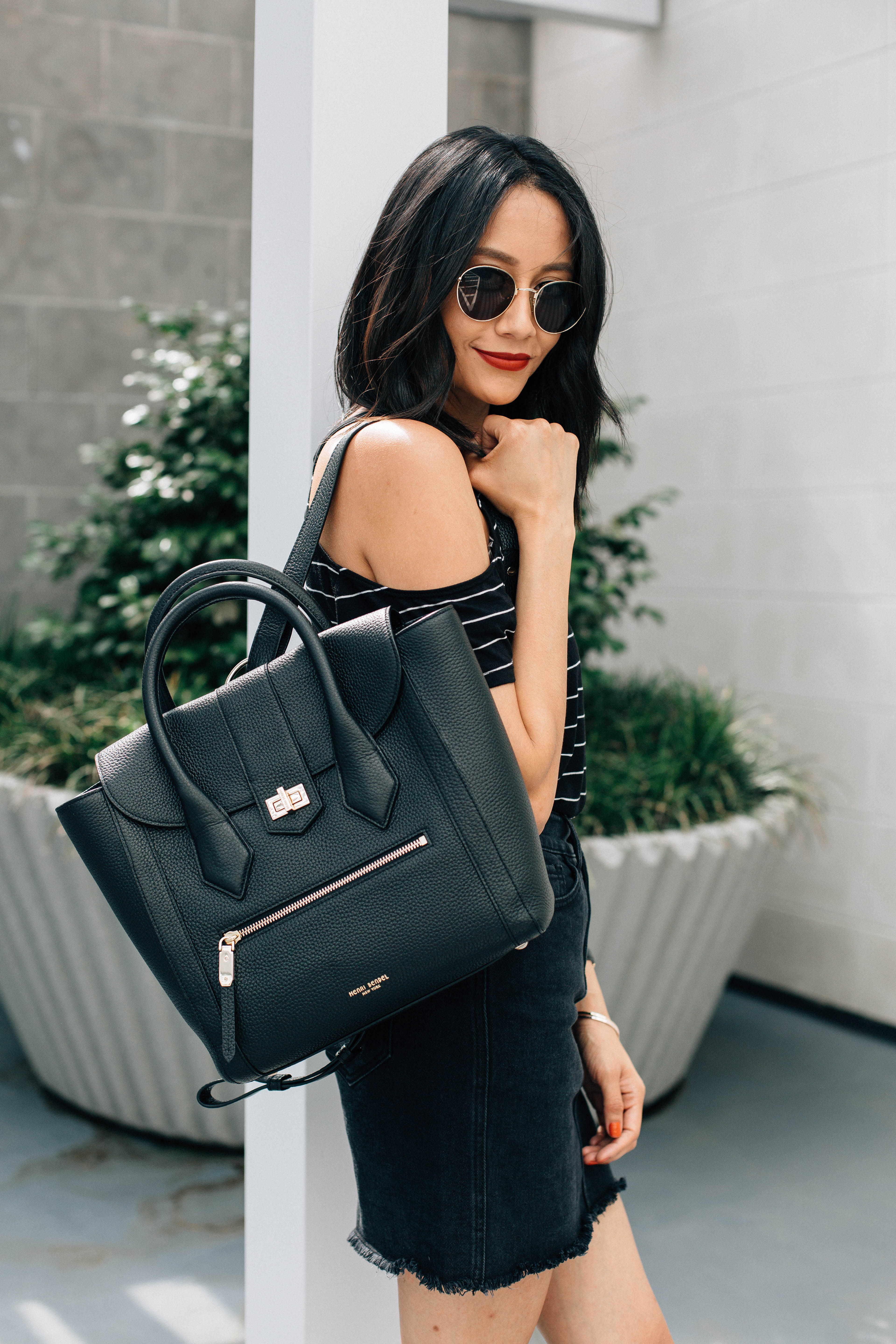 Lifestyle blogger Lilly Beltran of Daily Craving wearing a Henri Bendel bag and red matte lips