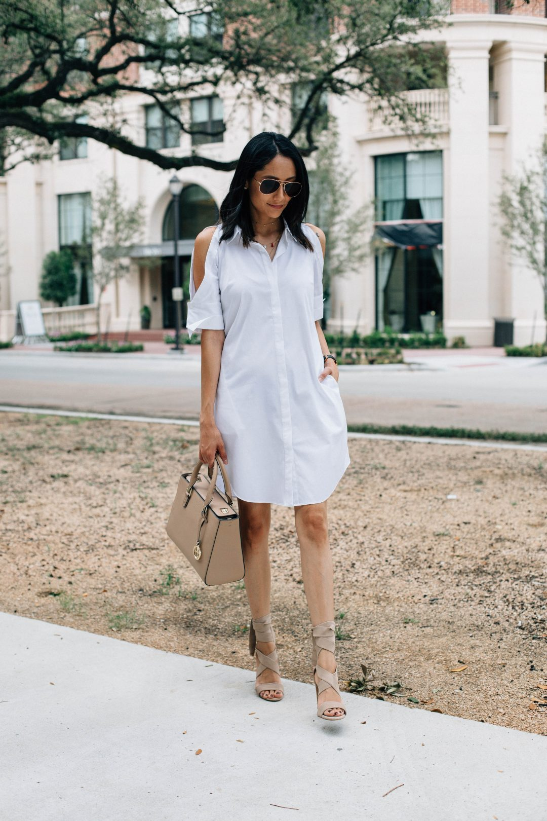 Lifestyle Blogger Lilly Beltran of Daily Craving wearing a white shirt dress and beige Henri Bendel