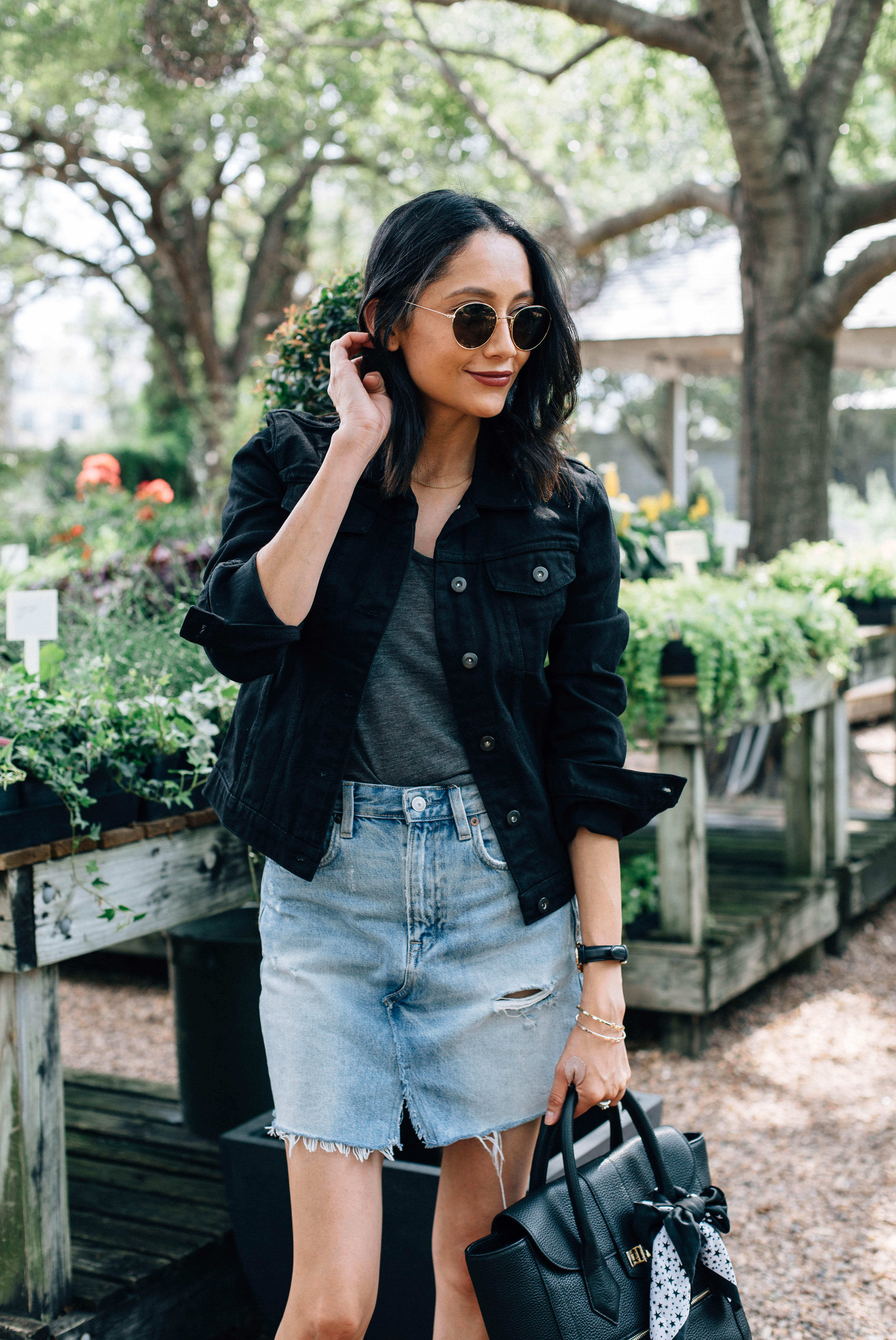Lifestyle blogger Lilly Beltran of Daily Craving wearing a denim mini skirt and a black denim jacket