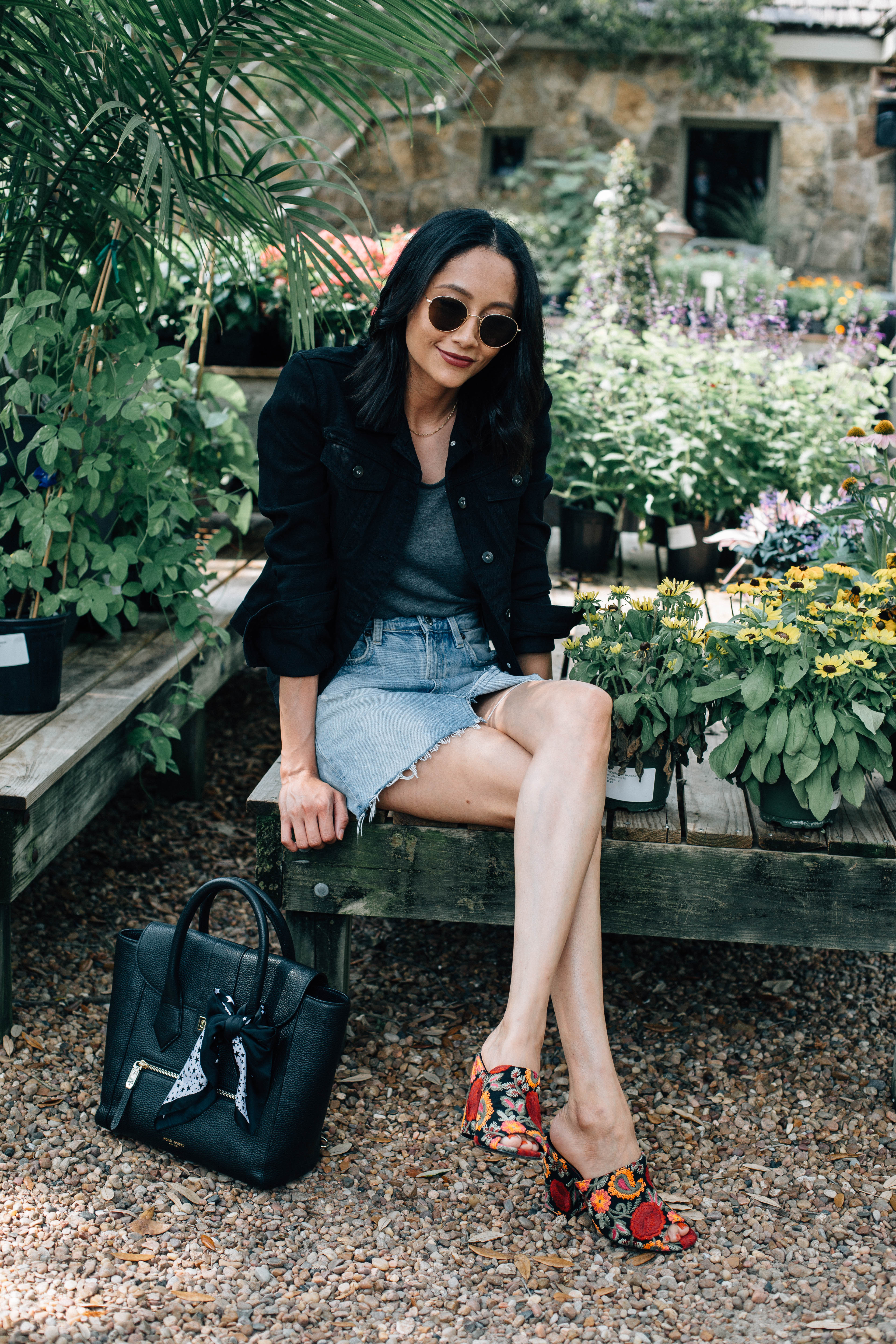 Lifestyle blogger Lilly Beltran wearing embroidered mules and Henri Bendel bag