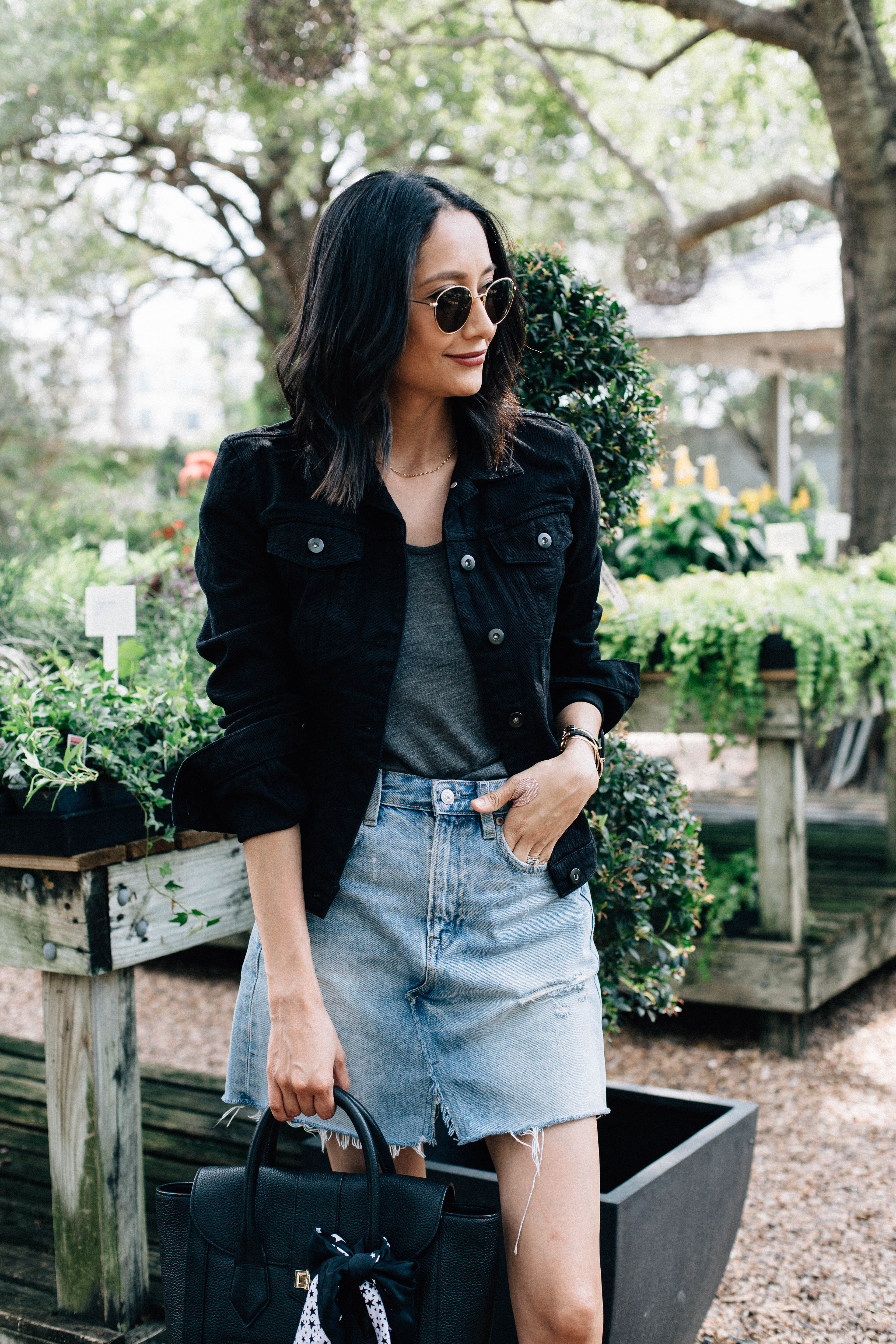 Lifestyle blogger Lilly Beltran of Daily Craving wearing a fall look with black denim jacket