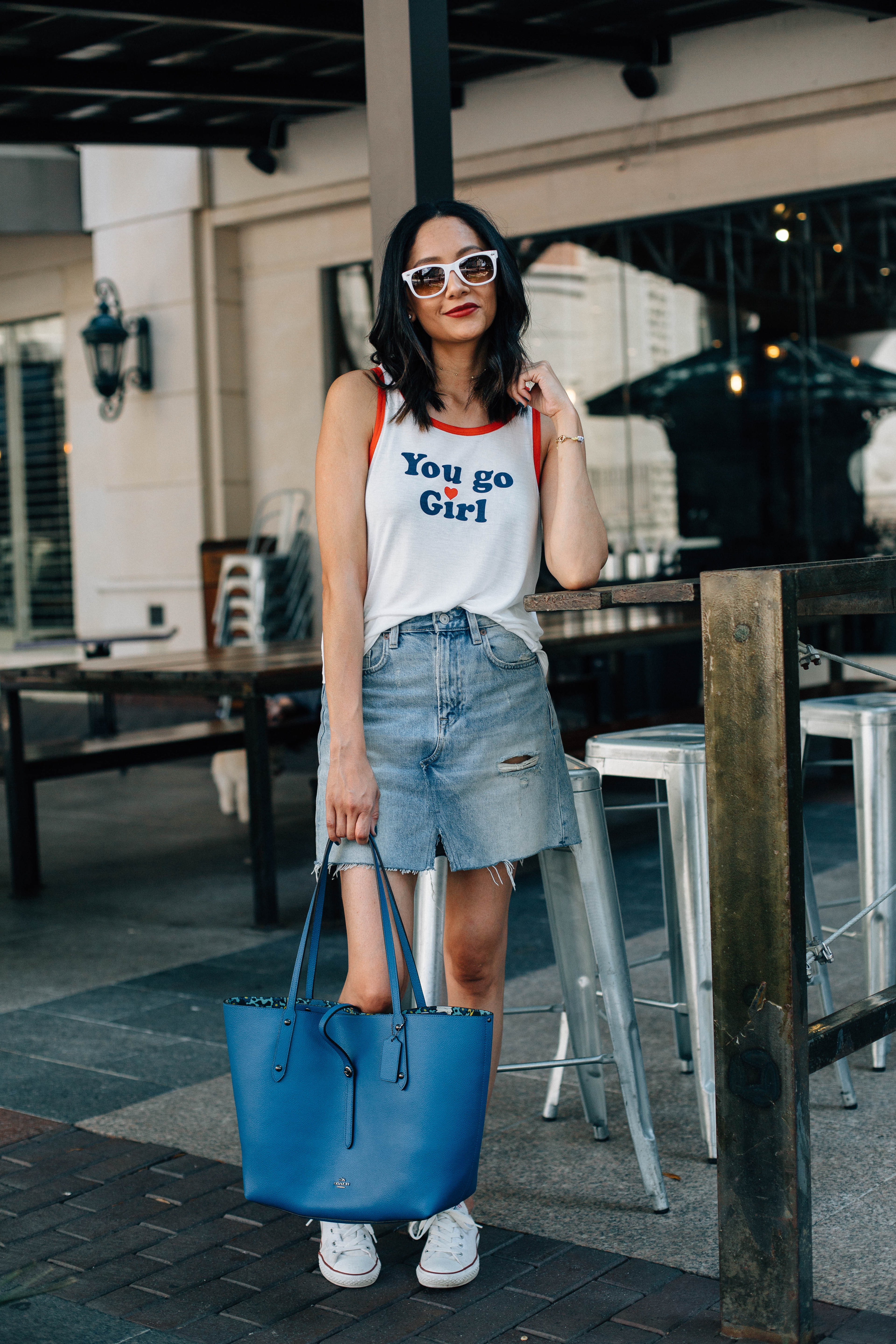 Lifestyle blogger Lilly Beltran of Daily Craving wearing denim with white Converse sneakers