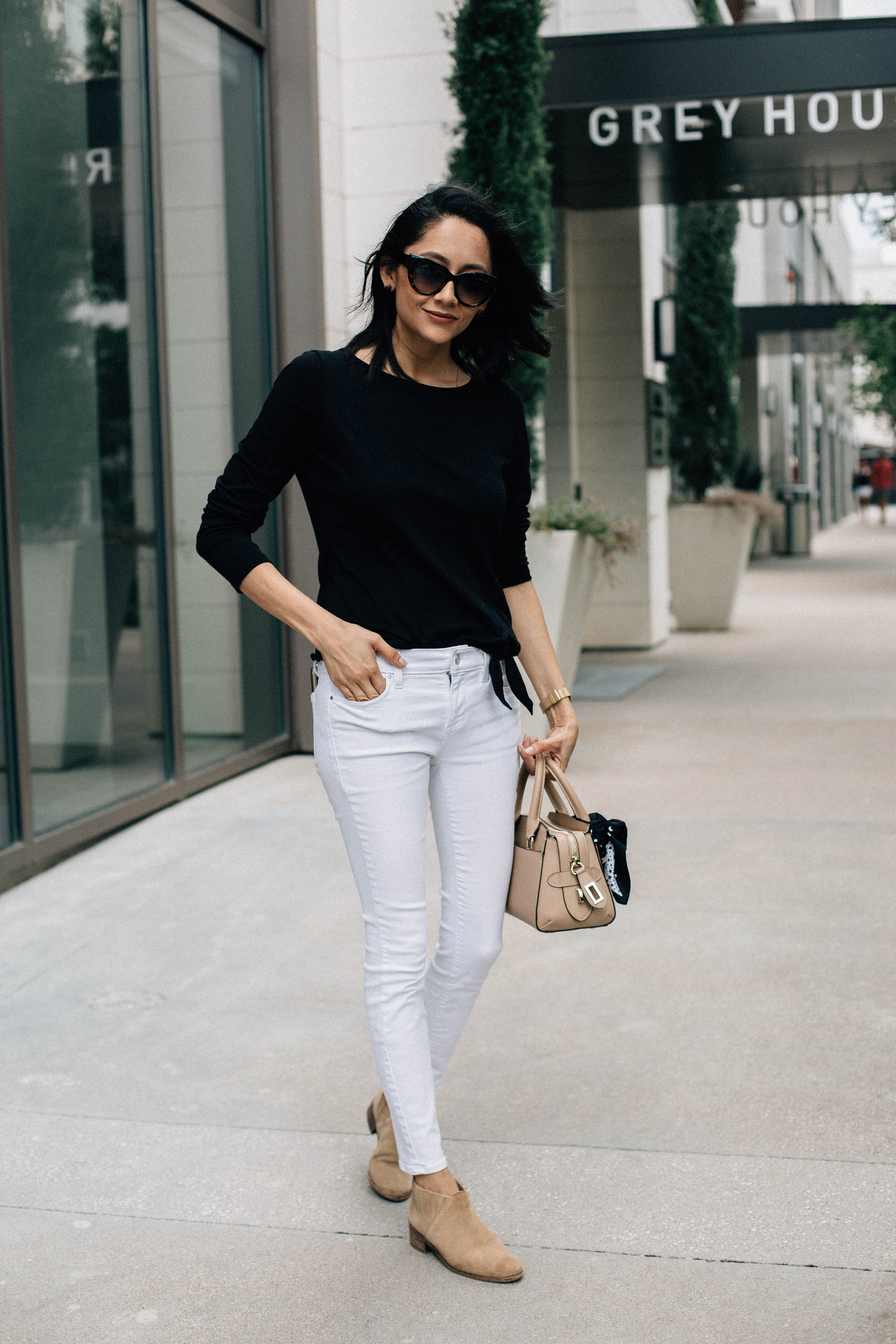 Lifestyle blogger Lilly Beltran wearing nude booties with white skinny jeans and black tee