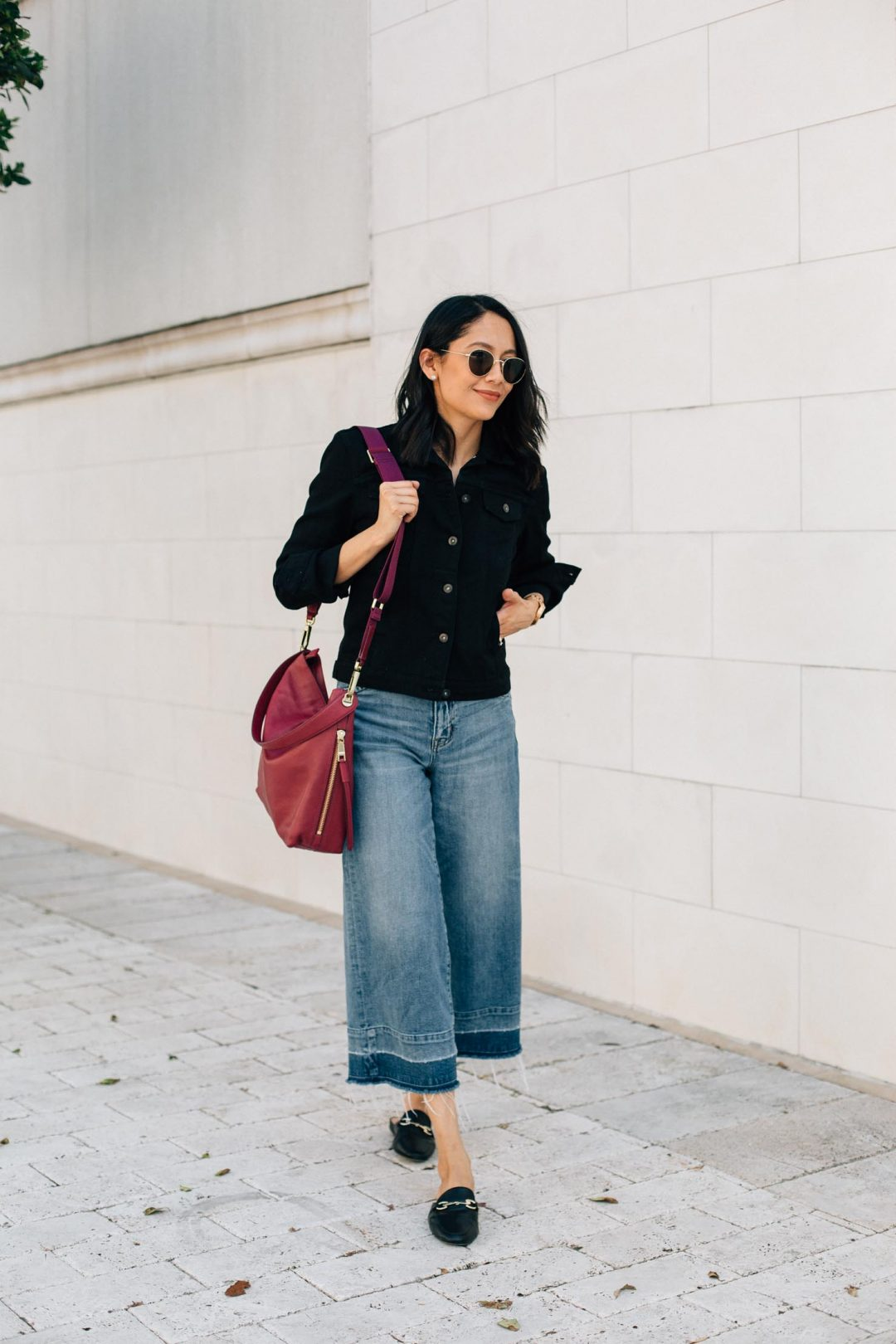 Lifestyle Blogger Lilly Beltran of Daily Craving in a fall look wearing a black denim jacket and wide leg denim
