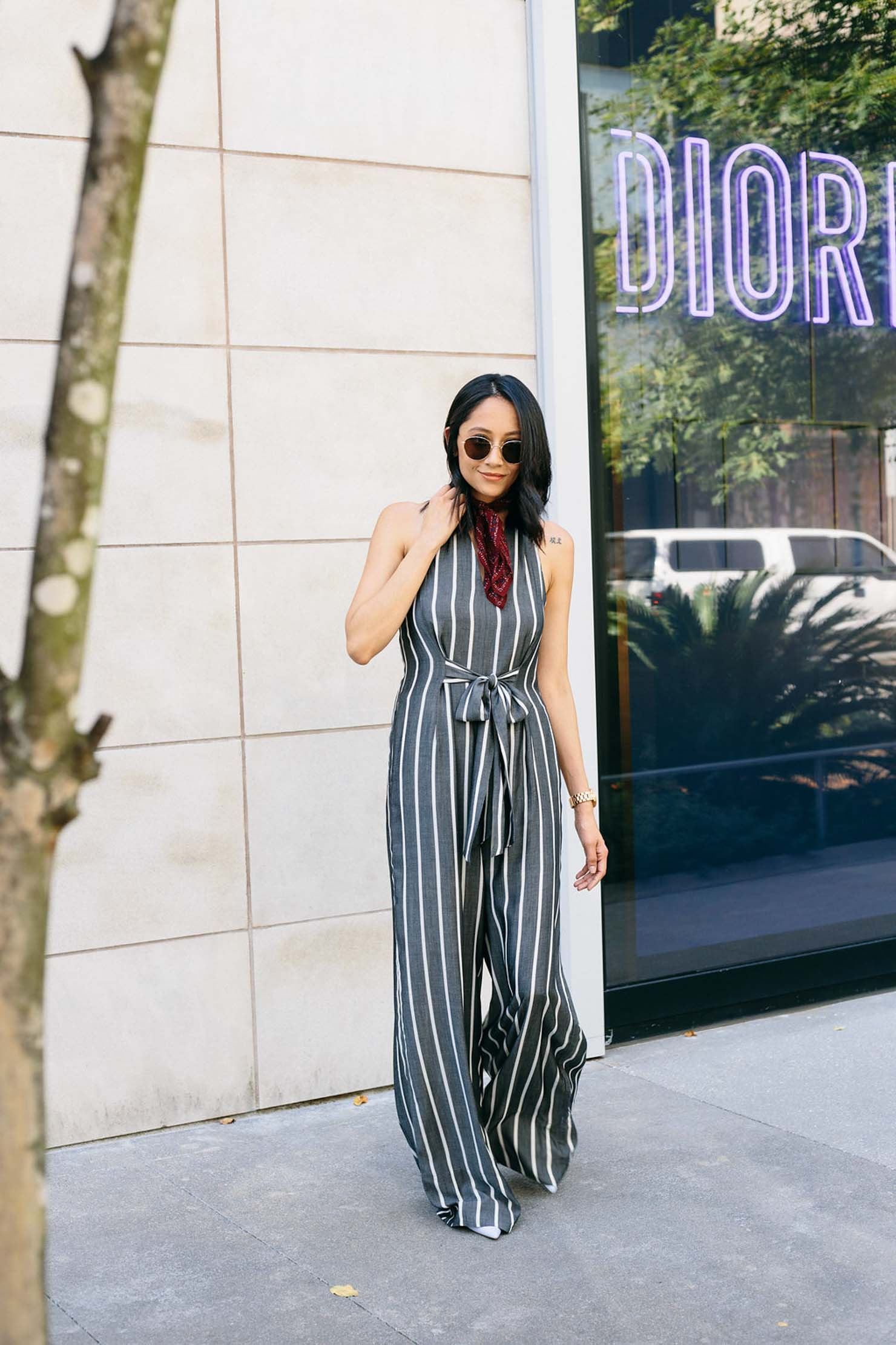 Lilly Beltran of Daily Craving blog in a striped jumpsuit and Burgundy bandana