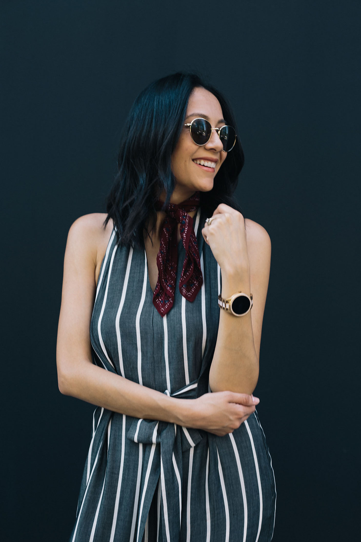 Style blogger Lilly Beltran of Daily Craving accessorizing with a red neckerchief and Fossil smartwatch