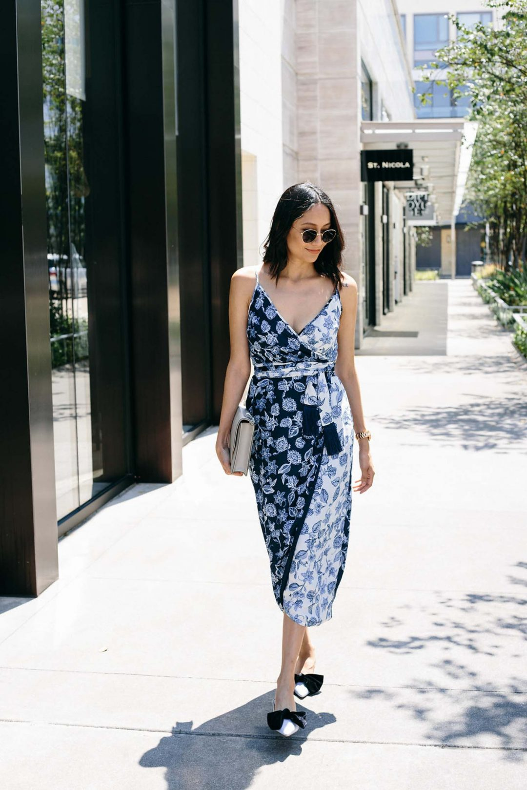 Lilly Beltran of Daily Craving blog in a chic look with. floral wrap dress and velvet bow kitten heels