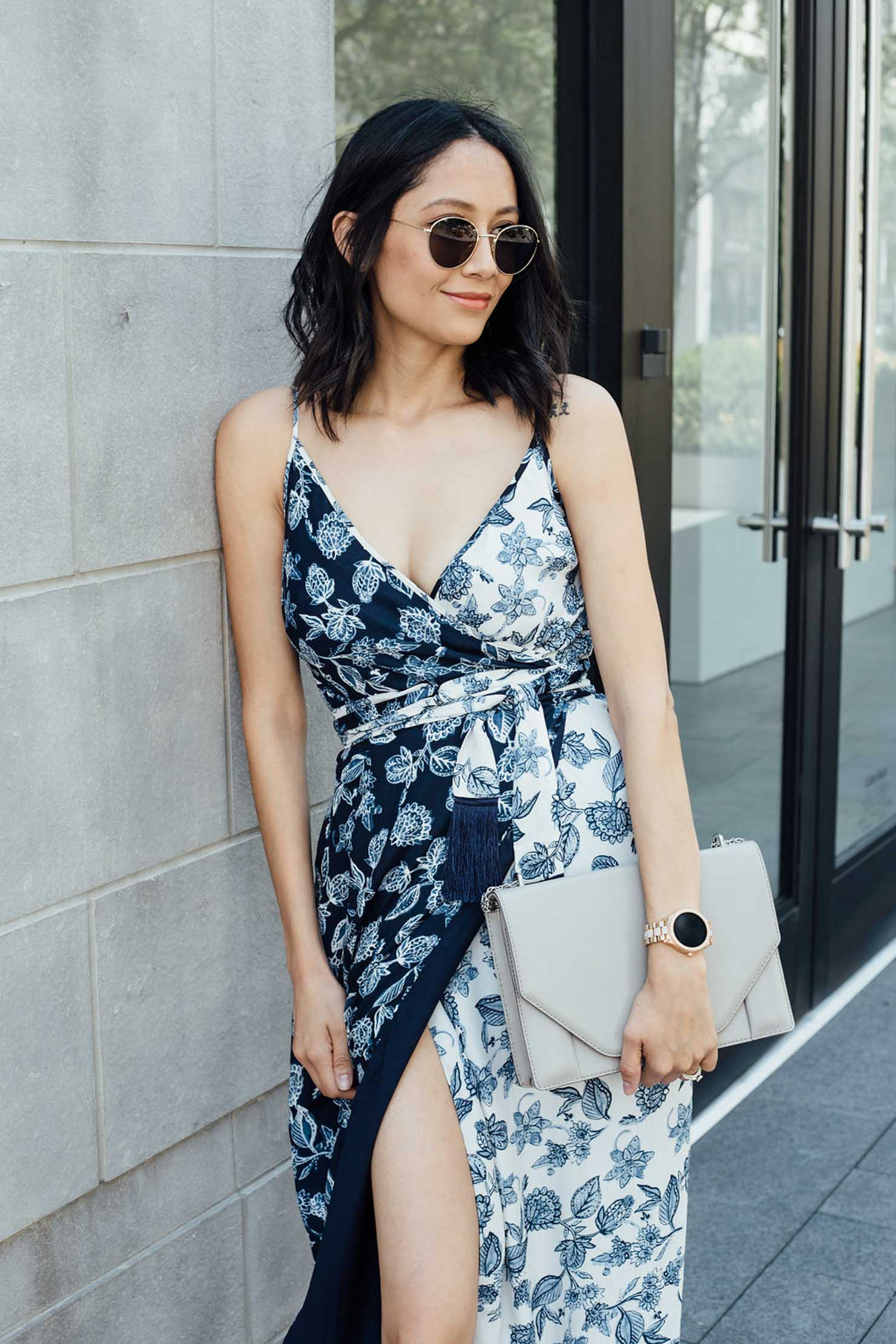 Style blogger Lilly Beltran wearing a Rachel Roy floral print wrap dress, Fossil smartwatch and Banana Republic grey envelope bag