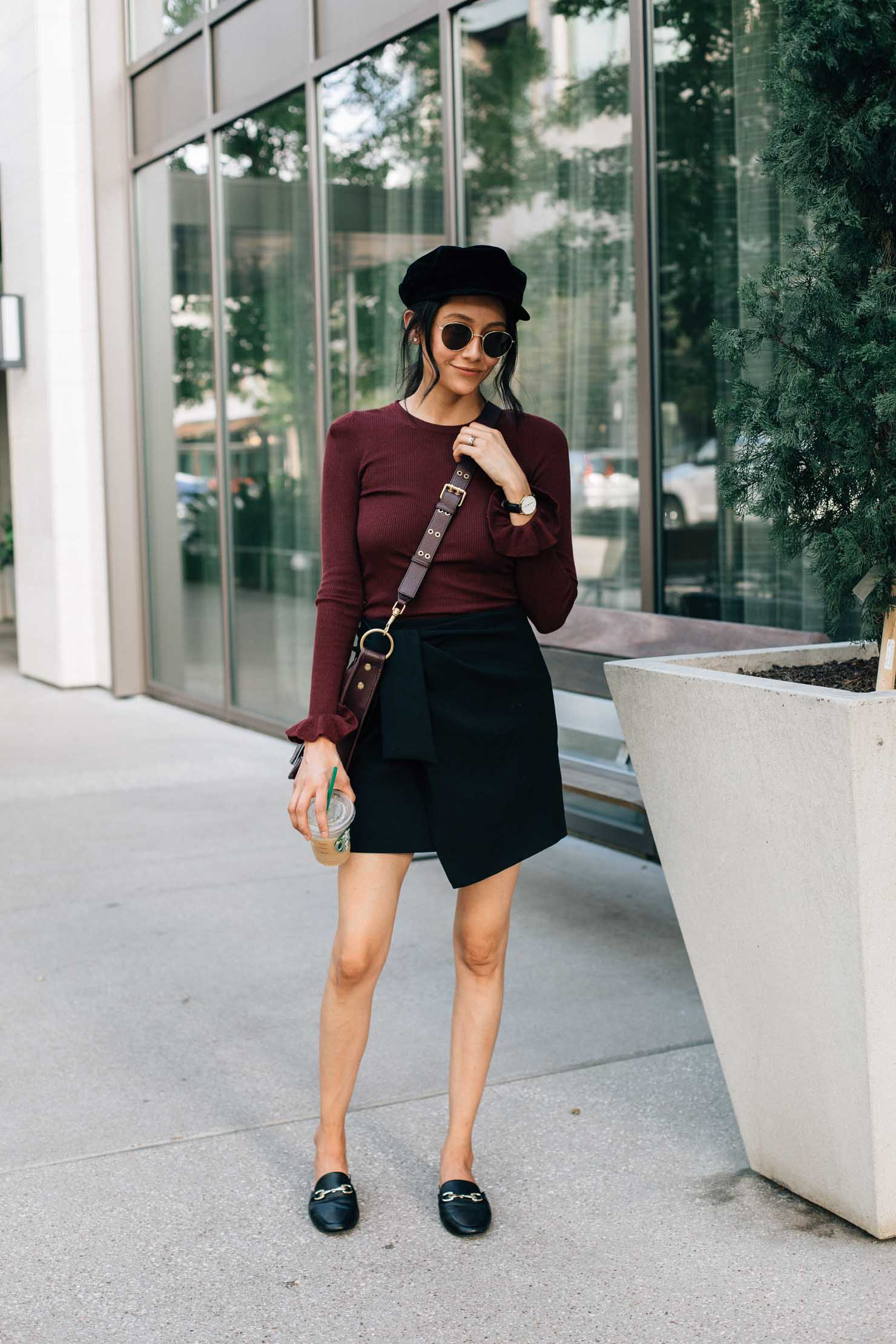 Fashion blogger Lilly Beltran of Daily Craving in a casual fall look with a burgundy sweater and black wrap skirt with a baker boy hat | Wear it twice