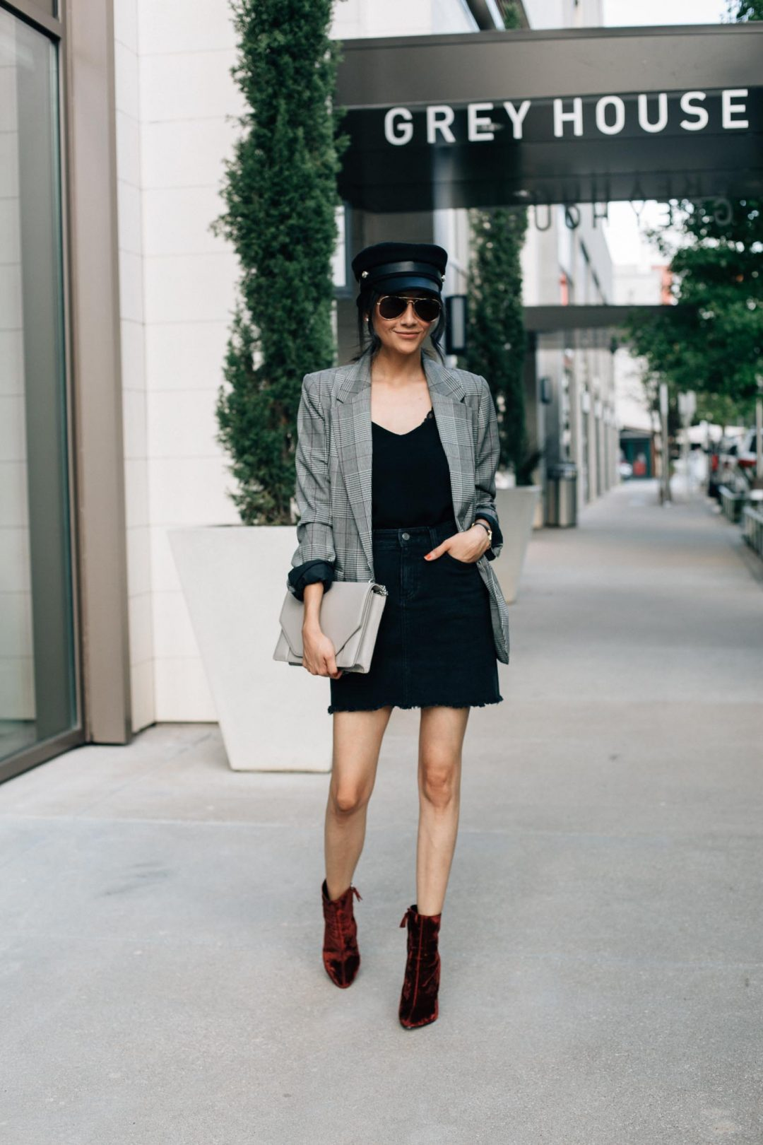 Style blogger Lilly Beltran of Daily Craving shares her favorite fall trends in a plaid blazer with a black denim skirt and red velvet boots