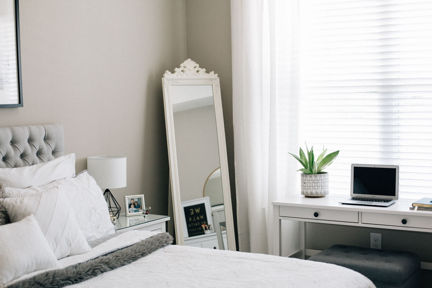 Lifestyle blogger Lilly Beltran of Daily Craving master bedroom reveal with grey tufted headboard and white bedding details