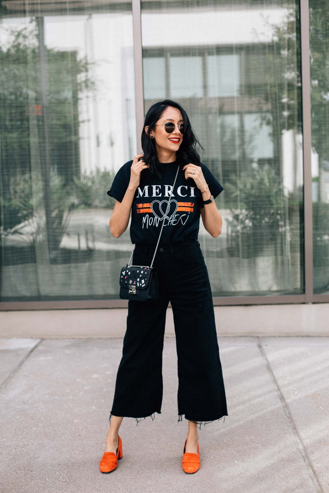 Fashion blogger Lilly Beltran of Daily Craving blog in a casual fall outfit with wide leg denim and printed tee