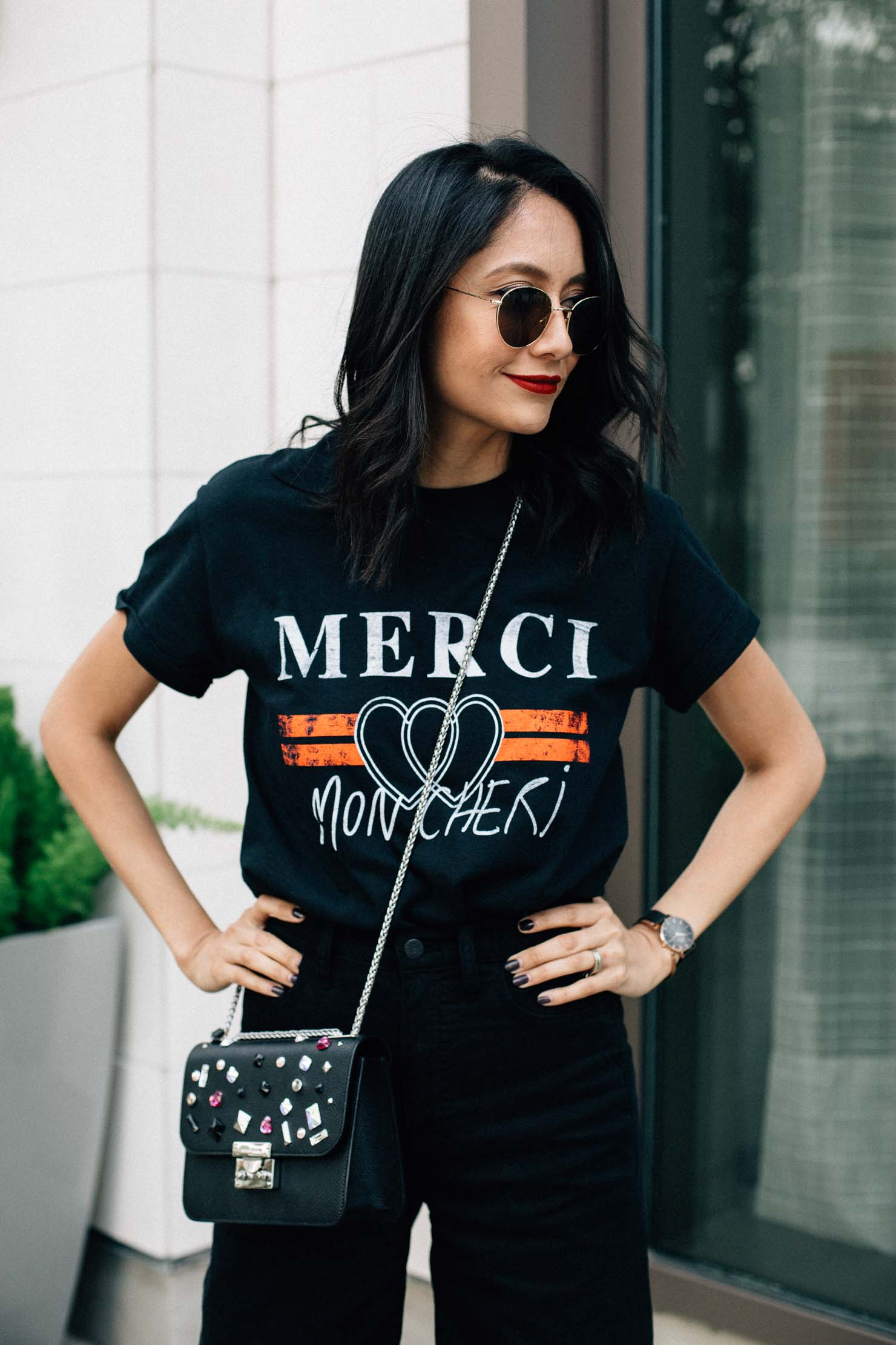 Fashion blogger Lilly Beltran of Daily Craving in a printed tee & Henri Bendel jewel bag