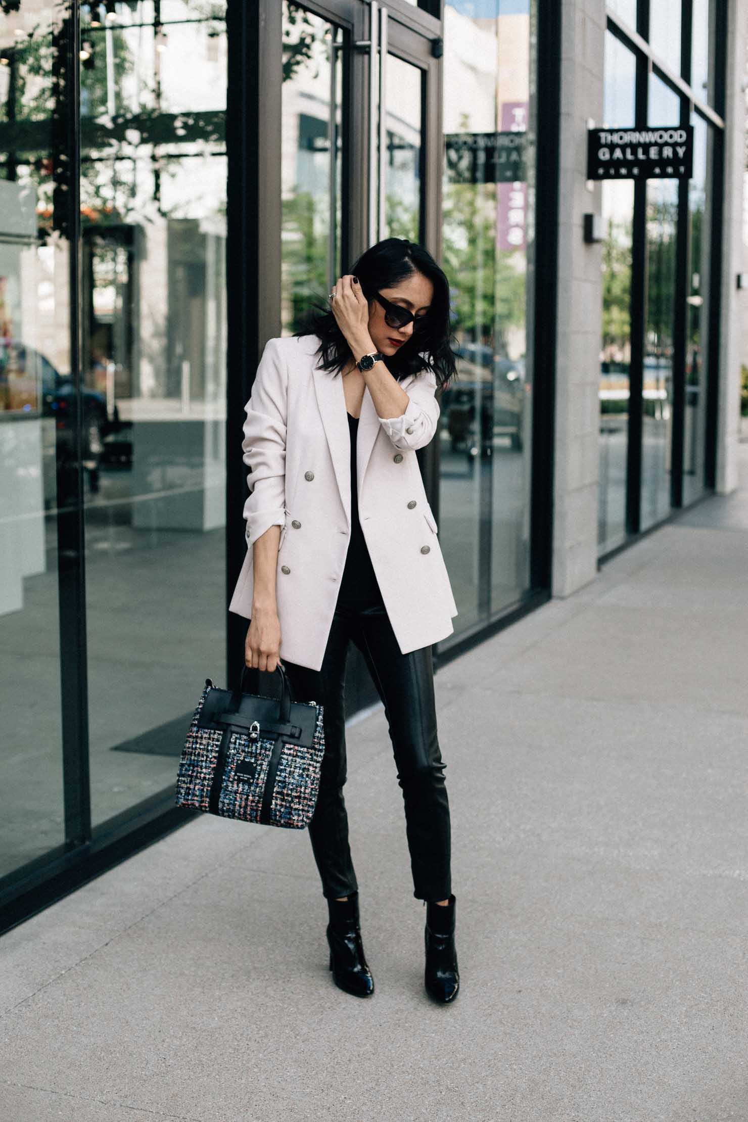 Fashion blogger Lilly Beltran of Daily Craving wearing Zara faux leather leggings with a blush Rachel Roy blazer, Vince Camuto patent leather boots and Henri Bendel tweed bag.