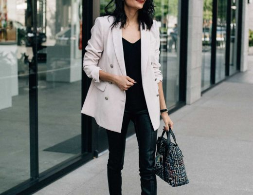 Lilly Beltran of Daily Craving blog in a chic fall look wearing faux leather leggings with a blue blazer and black patent leather boots