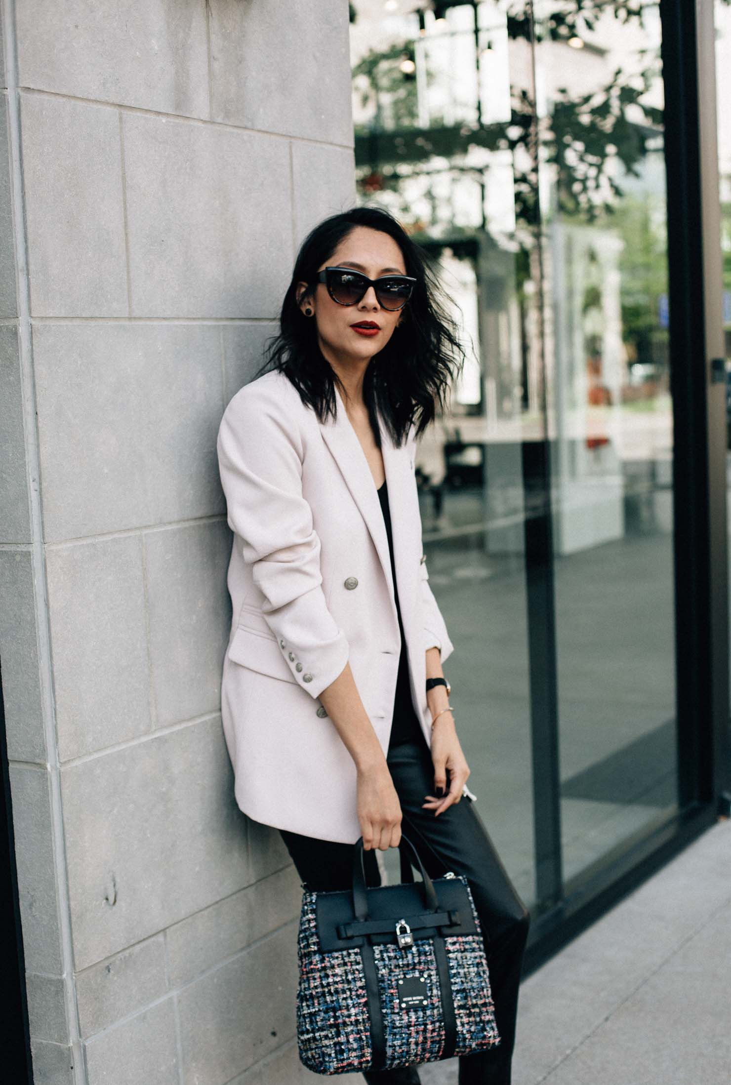Houston Based Fashion Blogger Lilly Beltran of Daily Craving wearing a Rachel Roy blush blazer and a Henri Bendel tweed Jetsetter bag