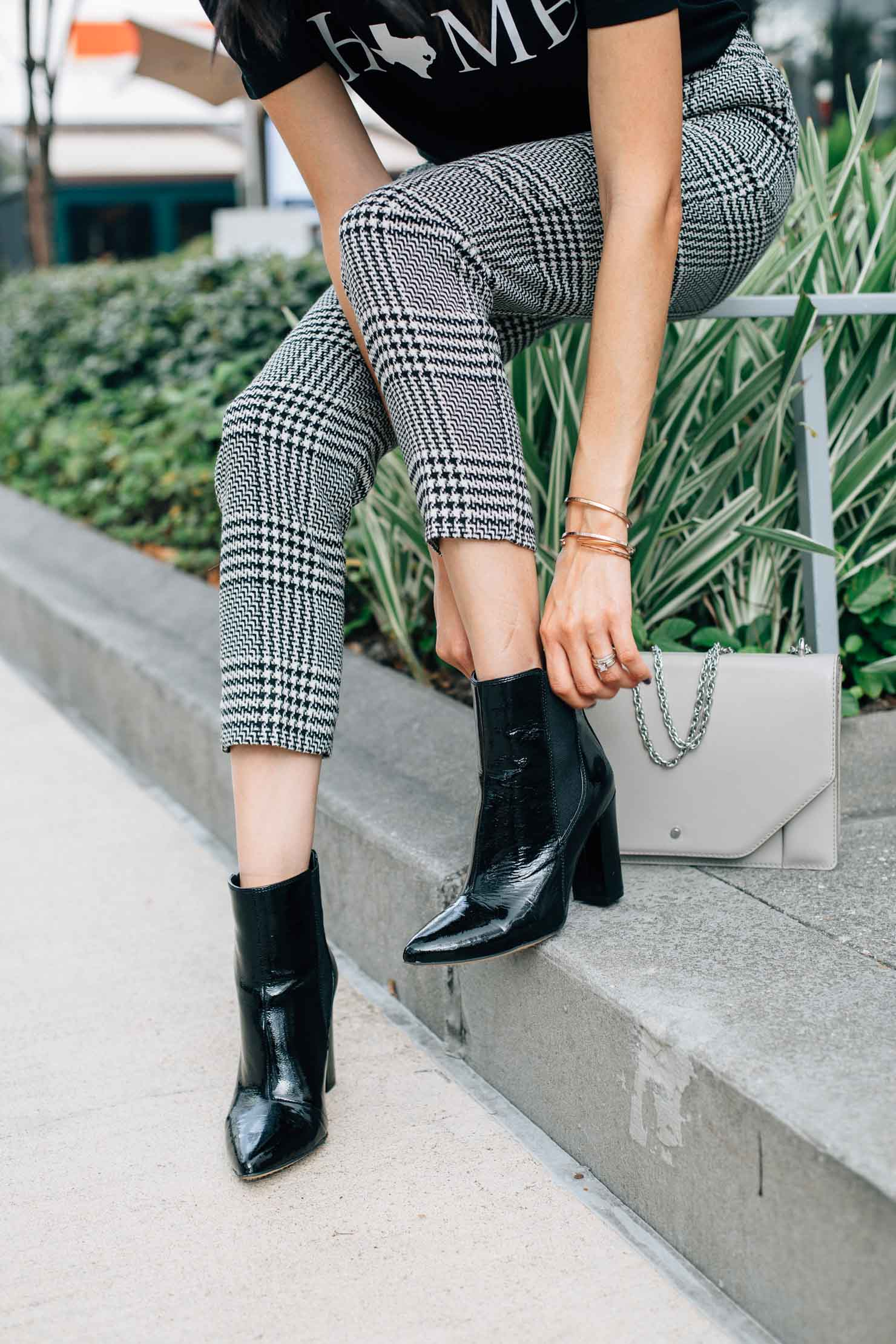 Style blogger Lilly Beltran of Daily Craving blog wearing Vince Camuto black patent leather ankle boots