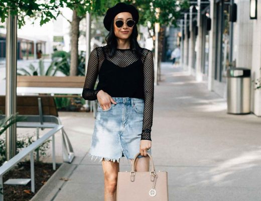 Fashion blogger Lilly Beltran of Daily Craving styles a long sleeve mesh top with a denim skirt and black beret