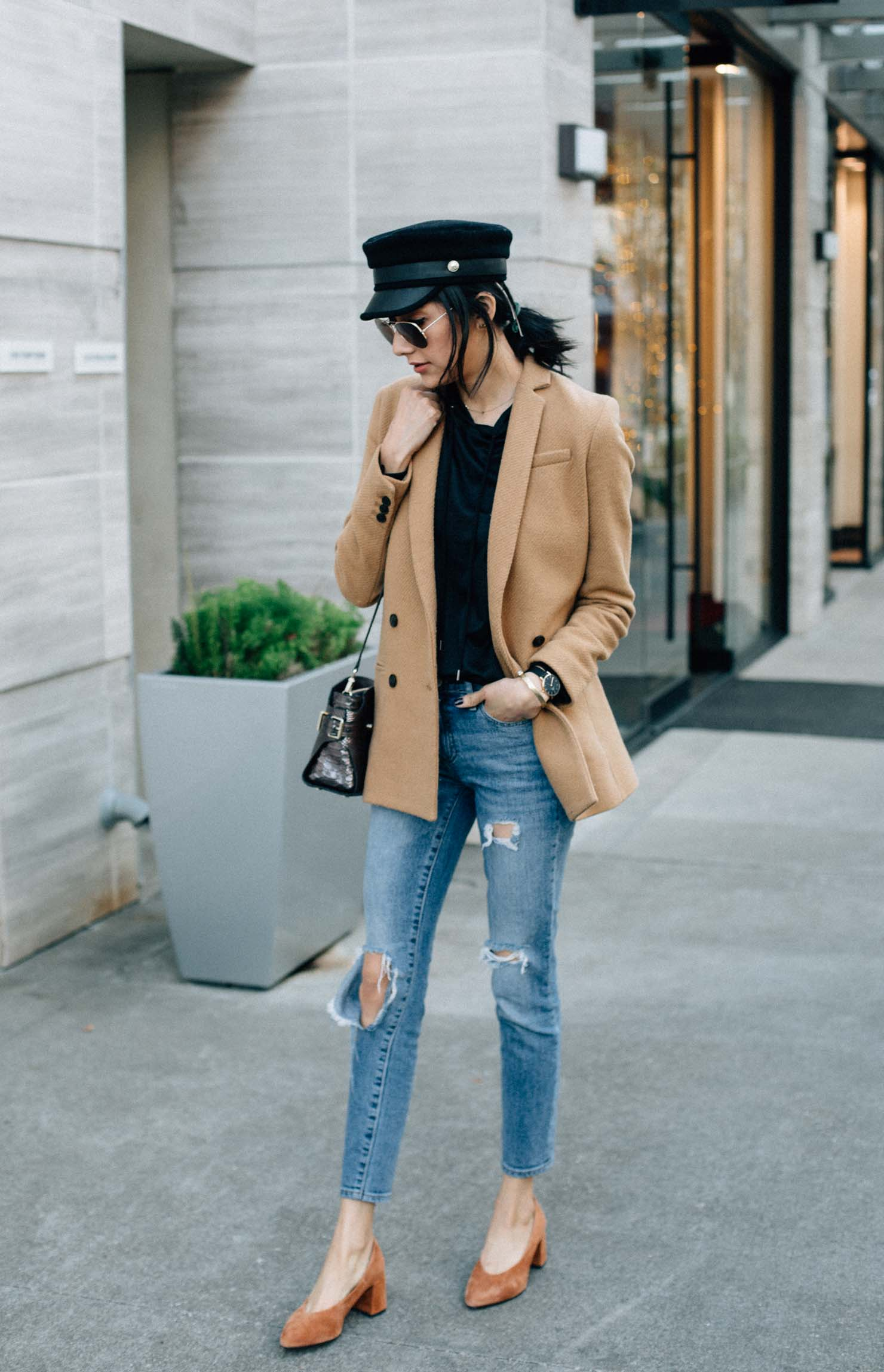 Lilly Beltran of Daily Craving blog wearing an outfit with her favorite black & camel color combination for fall and winter outfits