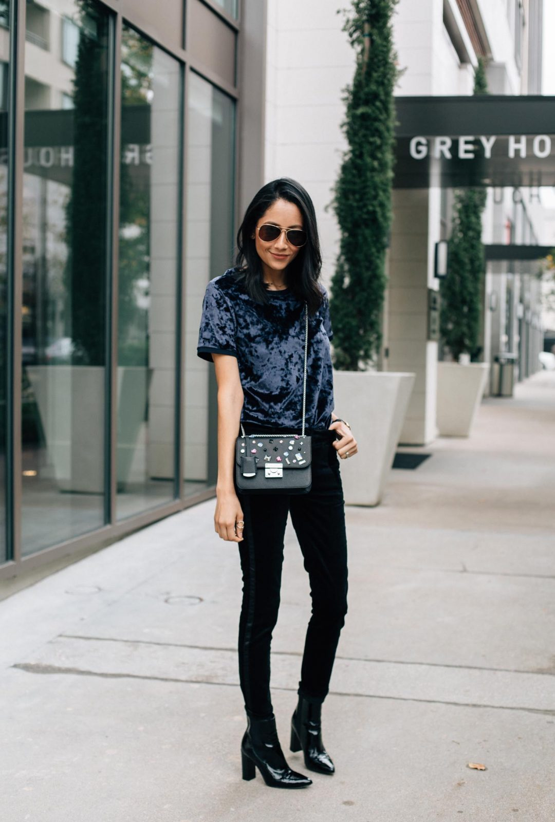 What do you want for Christmas? Lilly Beltran of Daily Craving wearing a holiday look with black velvet pants and a navy crushed velvet top