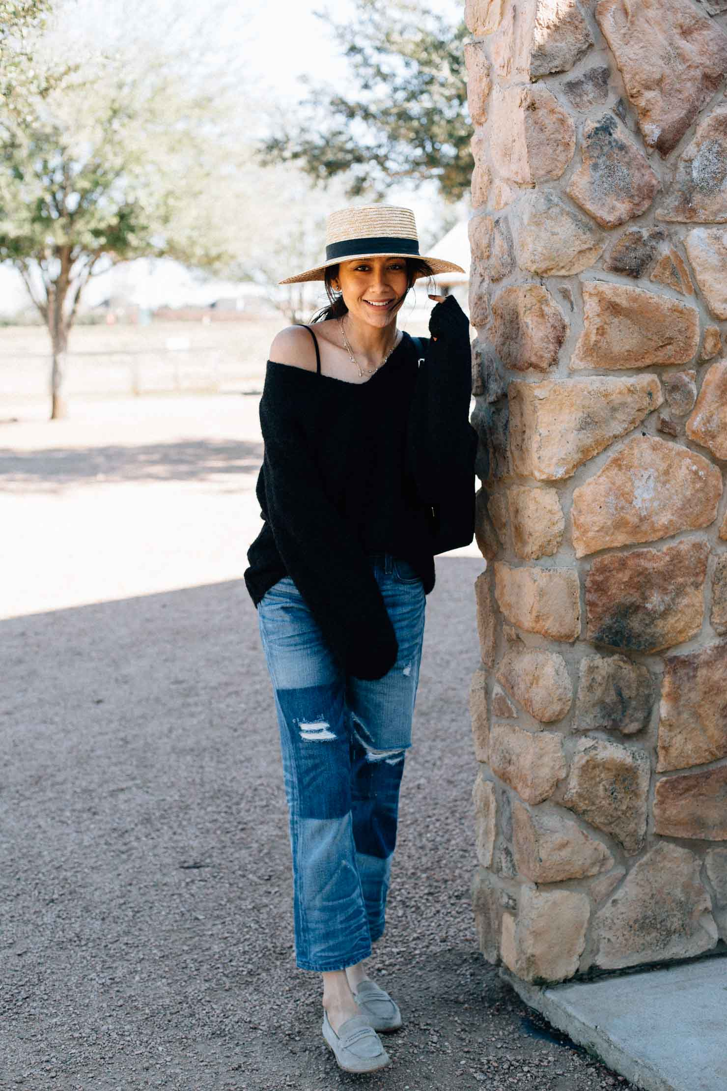 Fashion blogger Lilly Beltran of Daily Craving Blog wearing a pair of straight fit Jeans with an oversized sweater and suede loafers