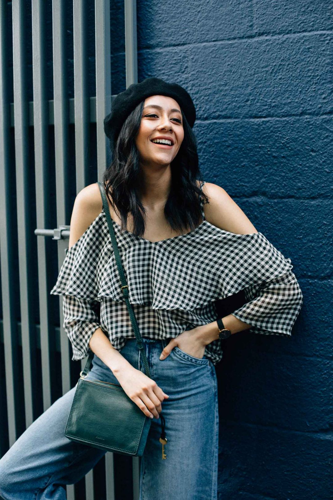 Houston based fashion blogger Lilly Beltran in a black & white Ten Sixty Sherman gingham top, wool beret and Fossil leather bag