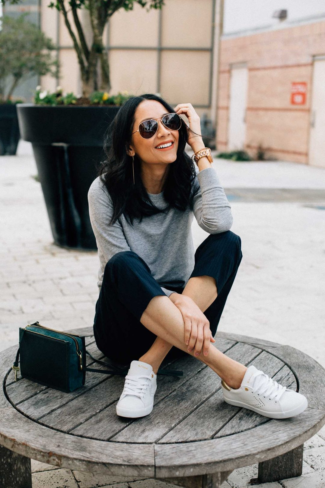A casual and chic way to wear sneakers and slacks | Houston based fashion blogger Lilly Beltran