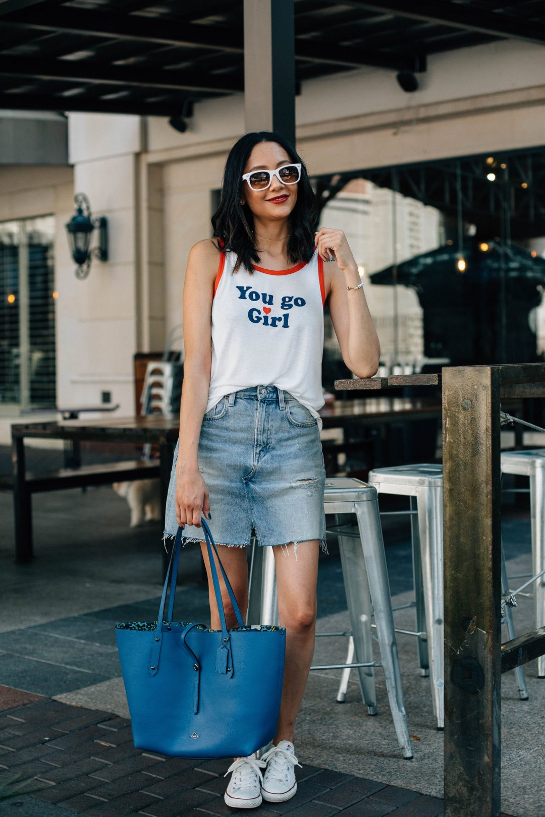 What to wear for fourth of July | Fourth of July outfit idea with a denim skirt and white sneakers