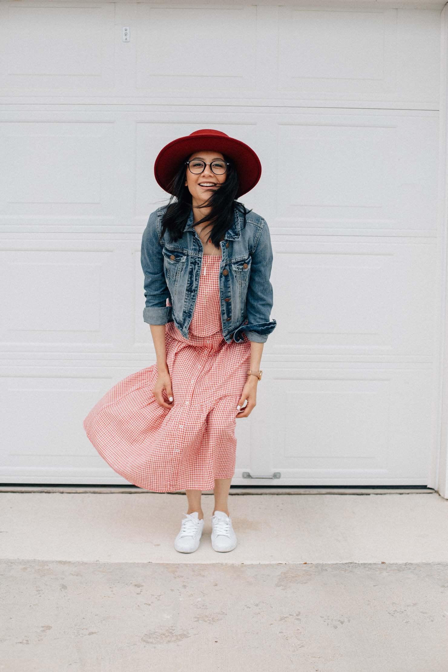 Fashion blogger Lilly Beltran wearing a red gingham set with a crop top and midi skirt.