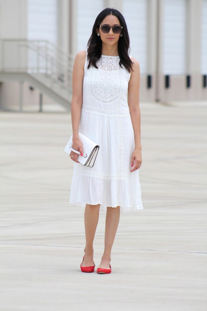 white lace midi dress with a statement shoe