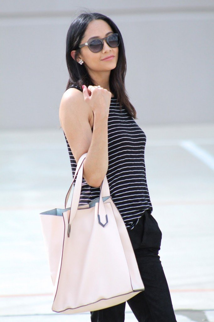 black suede joggers, stripped sleeveless tee, and blush tote.