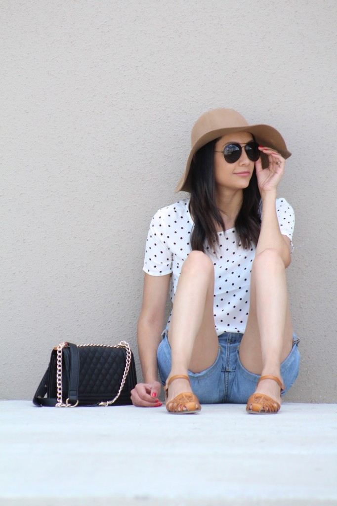 dotted top, denim shorts and floppy hat