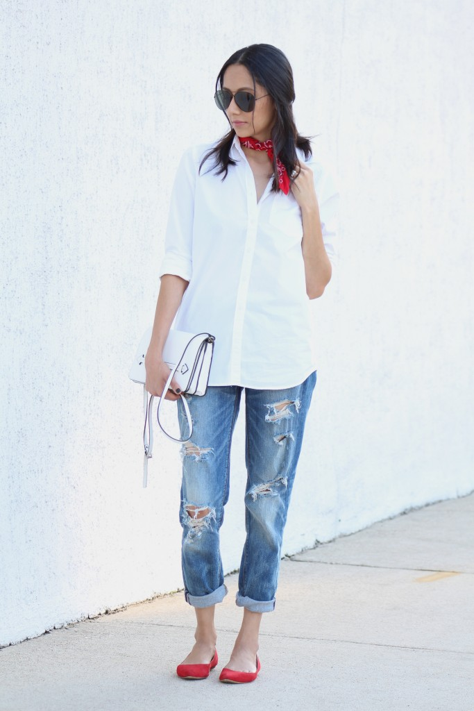 Houston style blogger Lilly Beltran of Daily Craving wearing a casual look with boyfriend jeans & a white button up shirt