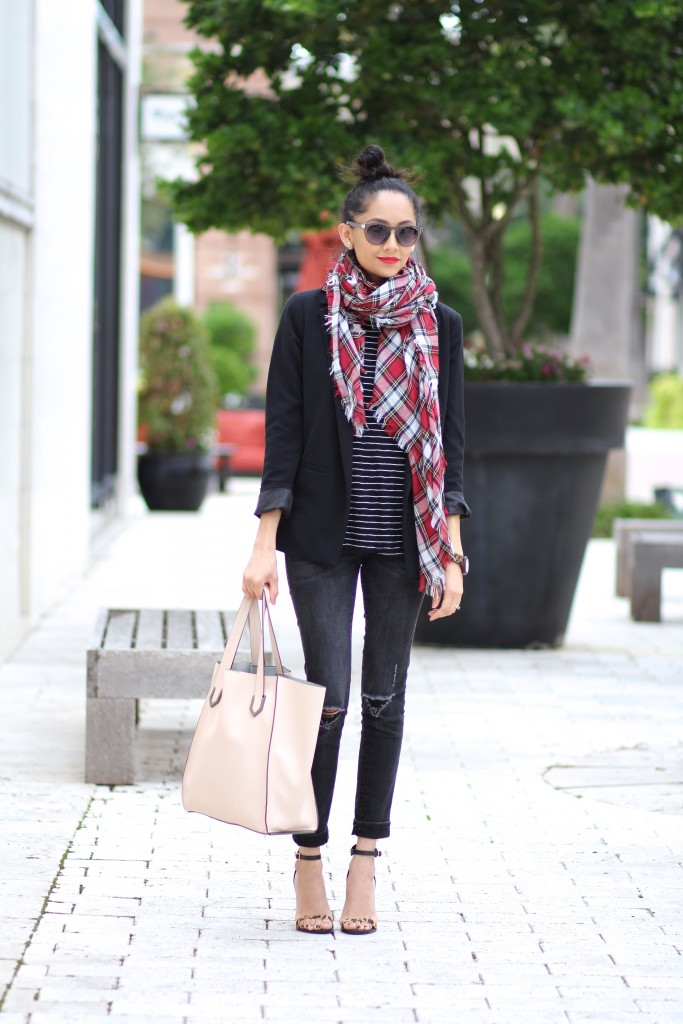 All black outfit with a red plaid scarf