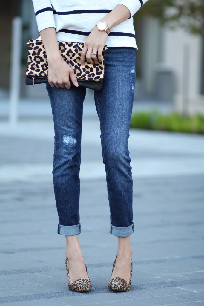 Striped shirt paired with leopard clutch and pumps