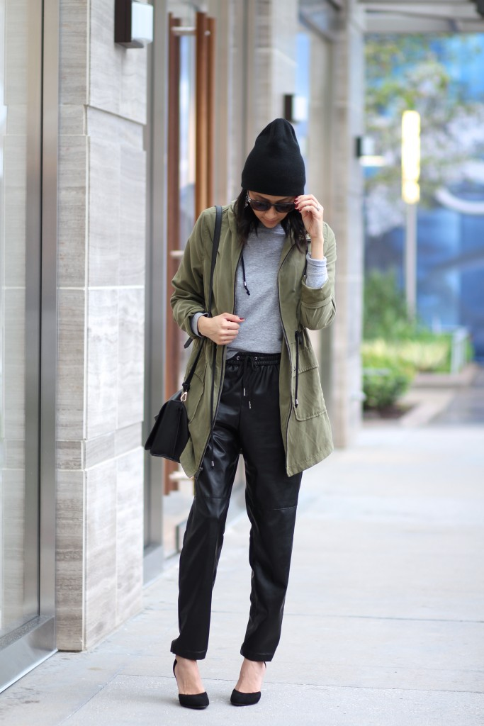 Black leather trousers & olive parka