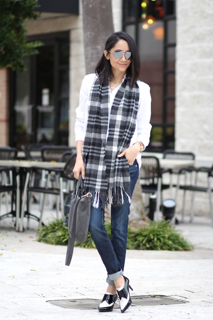 plaid scarf and black and white color blocked booties