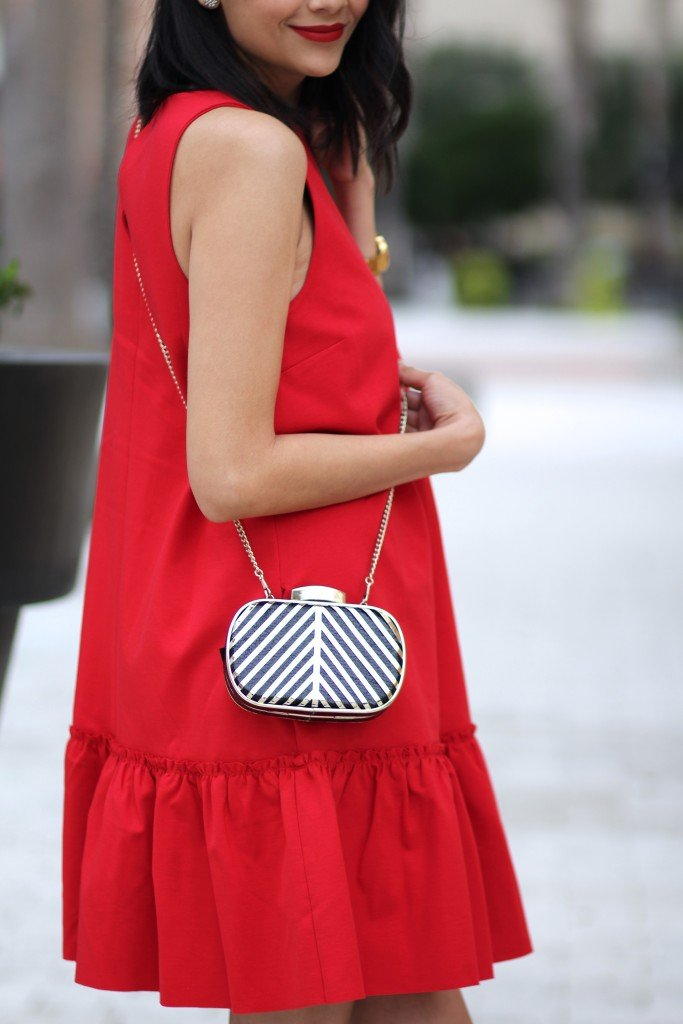 fashion blogger Lilly Beltran of Daily Craving in fall's IT color with a red dress and red lipstick