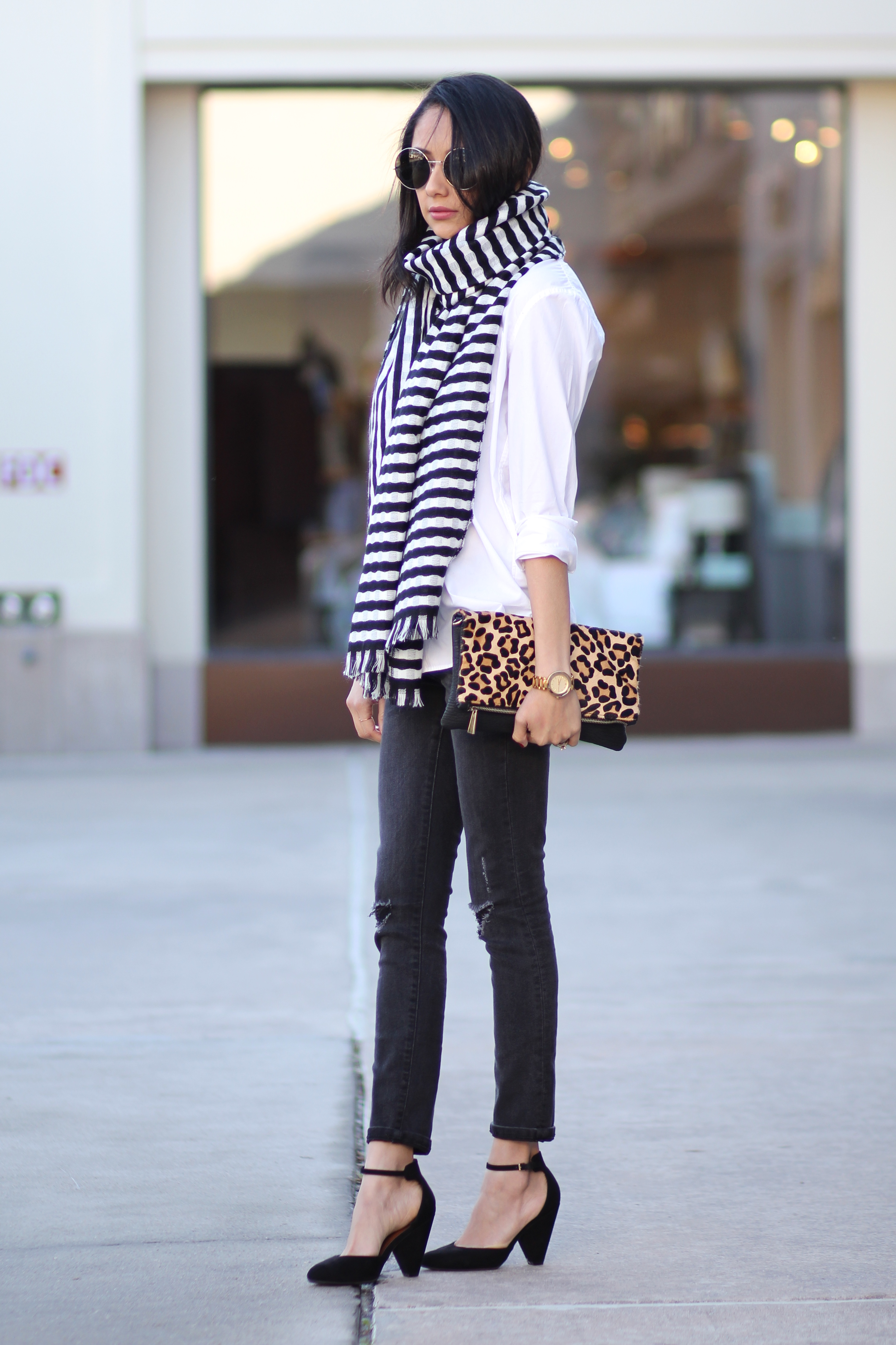 Blogger Lilly Beltran of Daily Craving in a Fall Casual look in a striped blanket scarf and skinny jeans