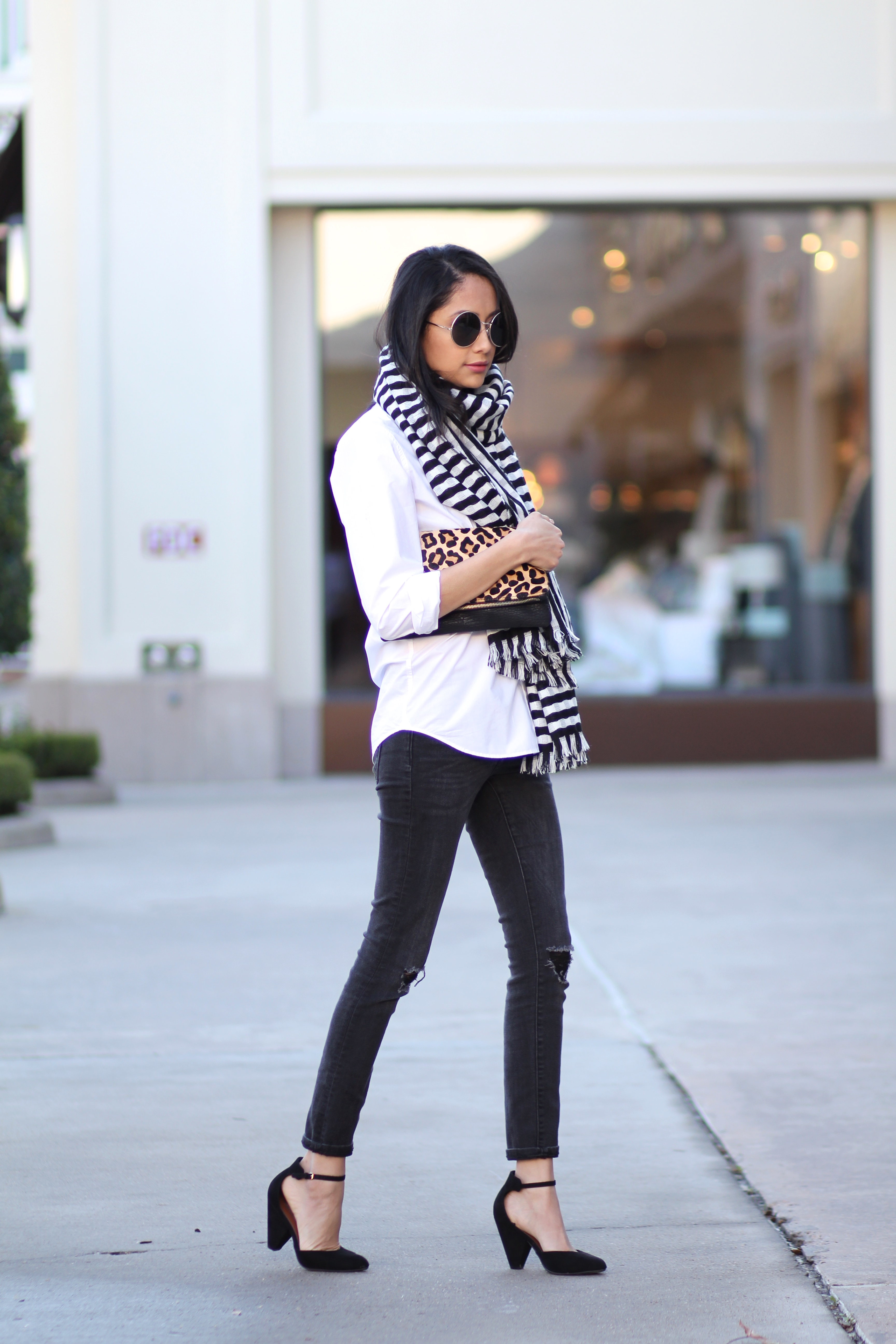 Lifestyle blogger Lilly Beltran in a casual fall look wearing a striped scarf and skinny jeans
