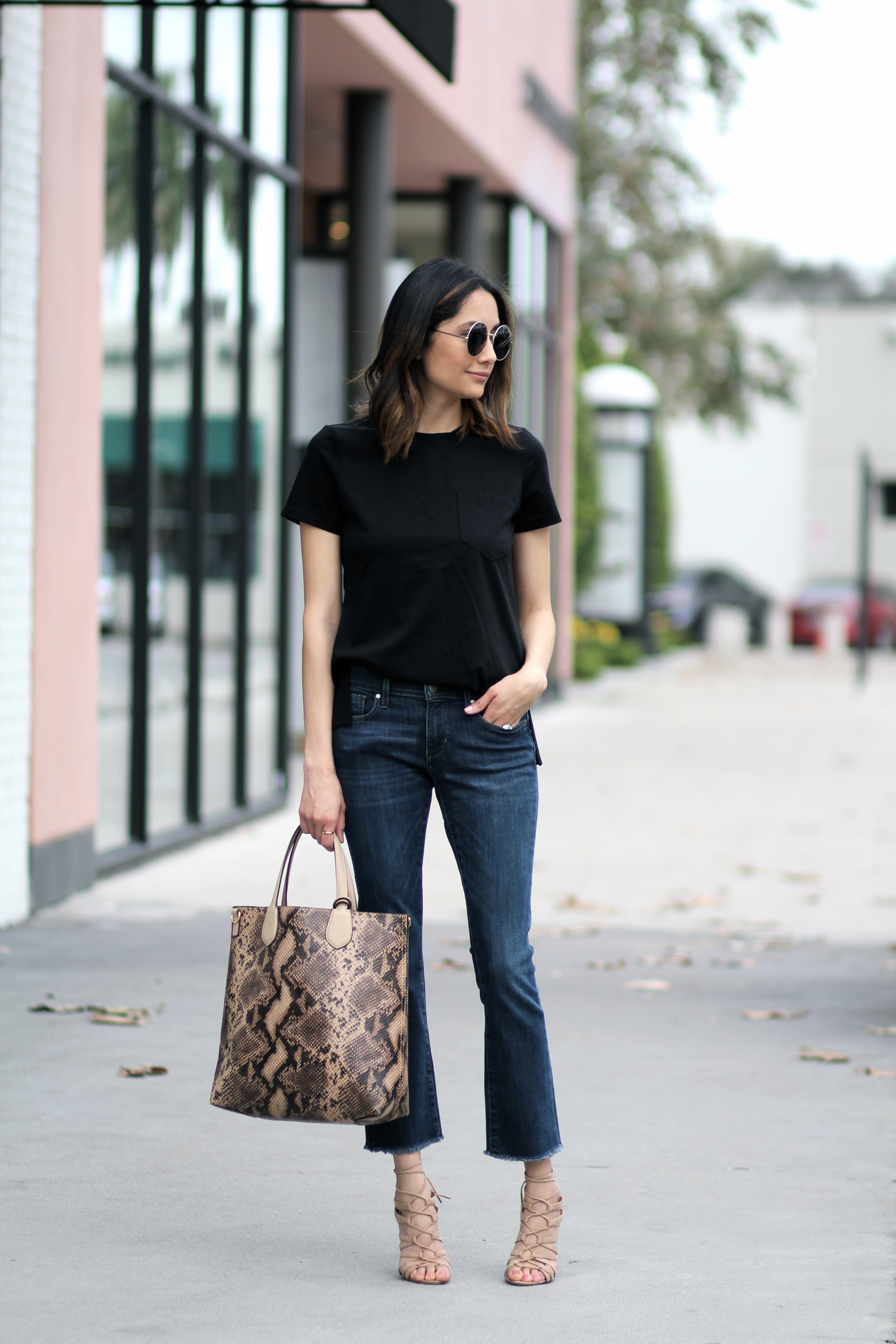 Lifestyle blogger Lilly Beltran of Daily Caving wearing flare jeans and a black basic tee