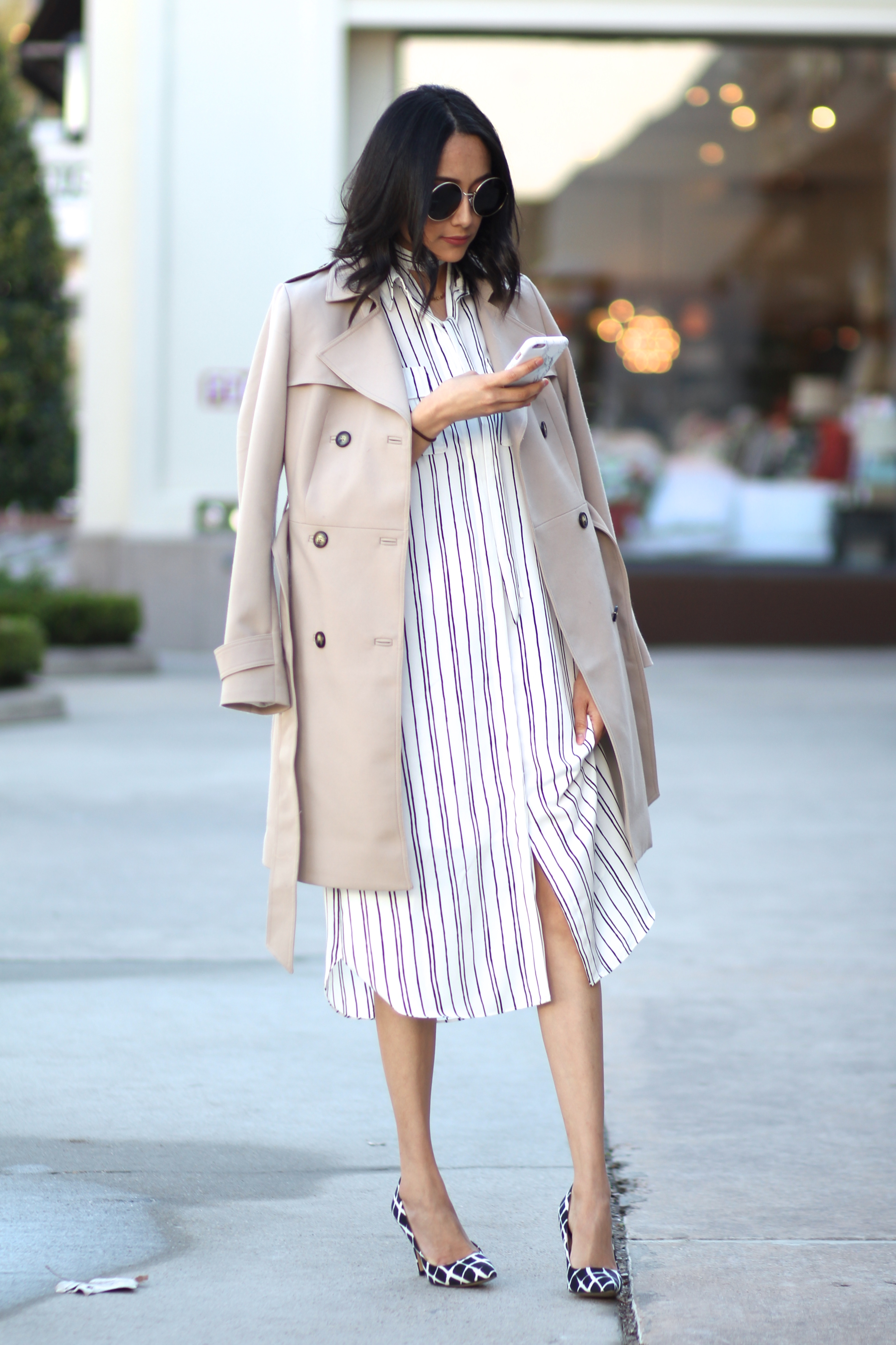 pinstripe dress, trench coat, and plaid pumps