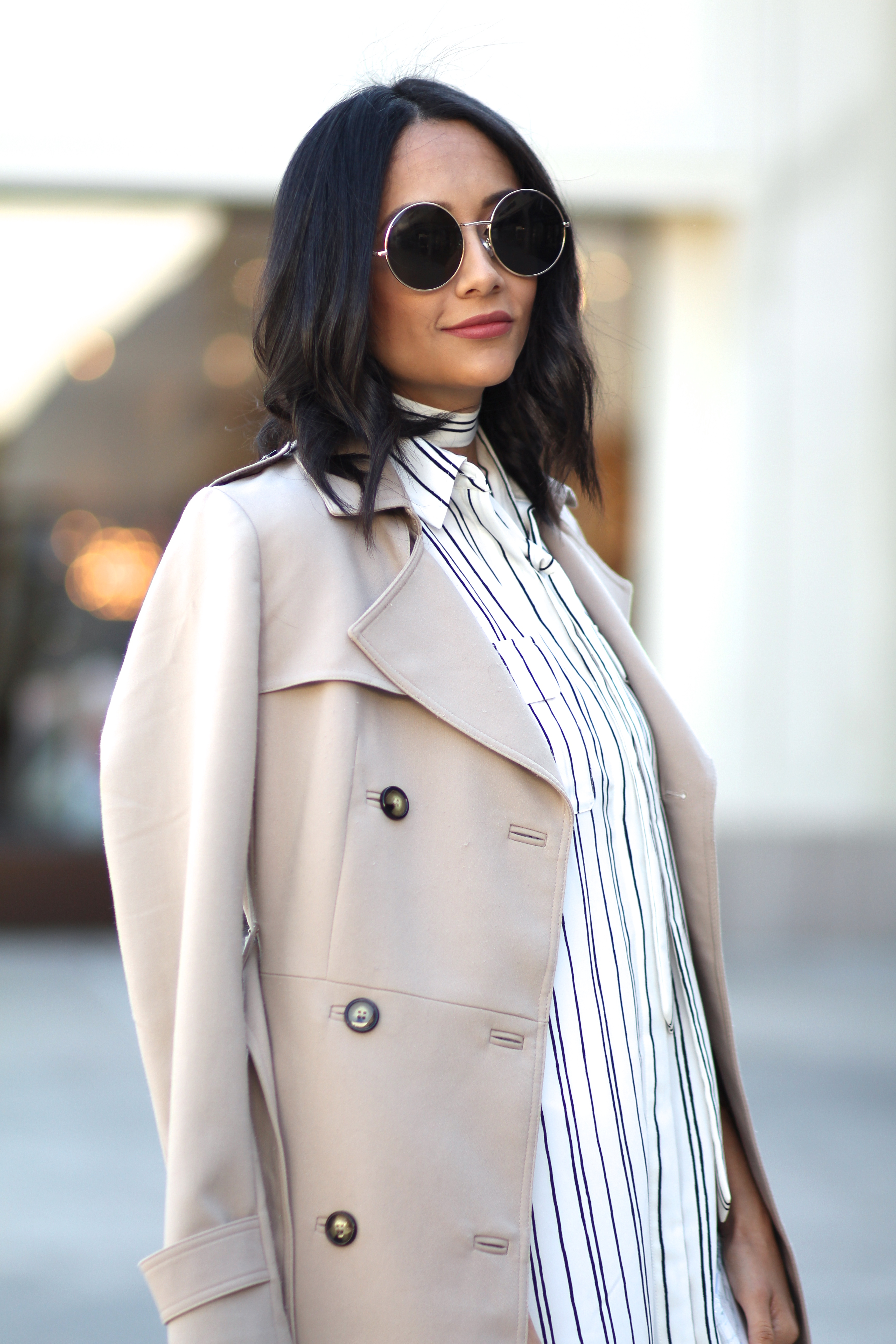 pair a pinstripe shirt dress with a classic trench