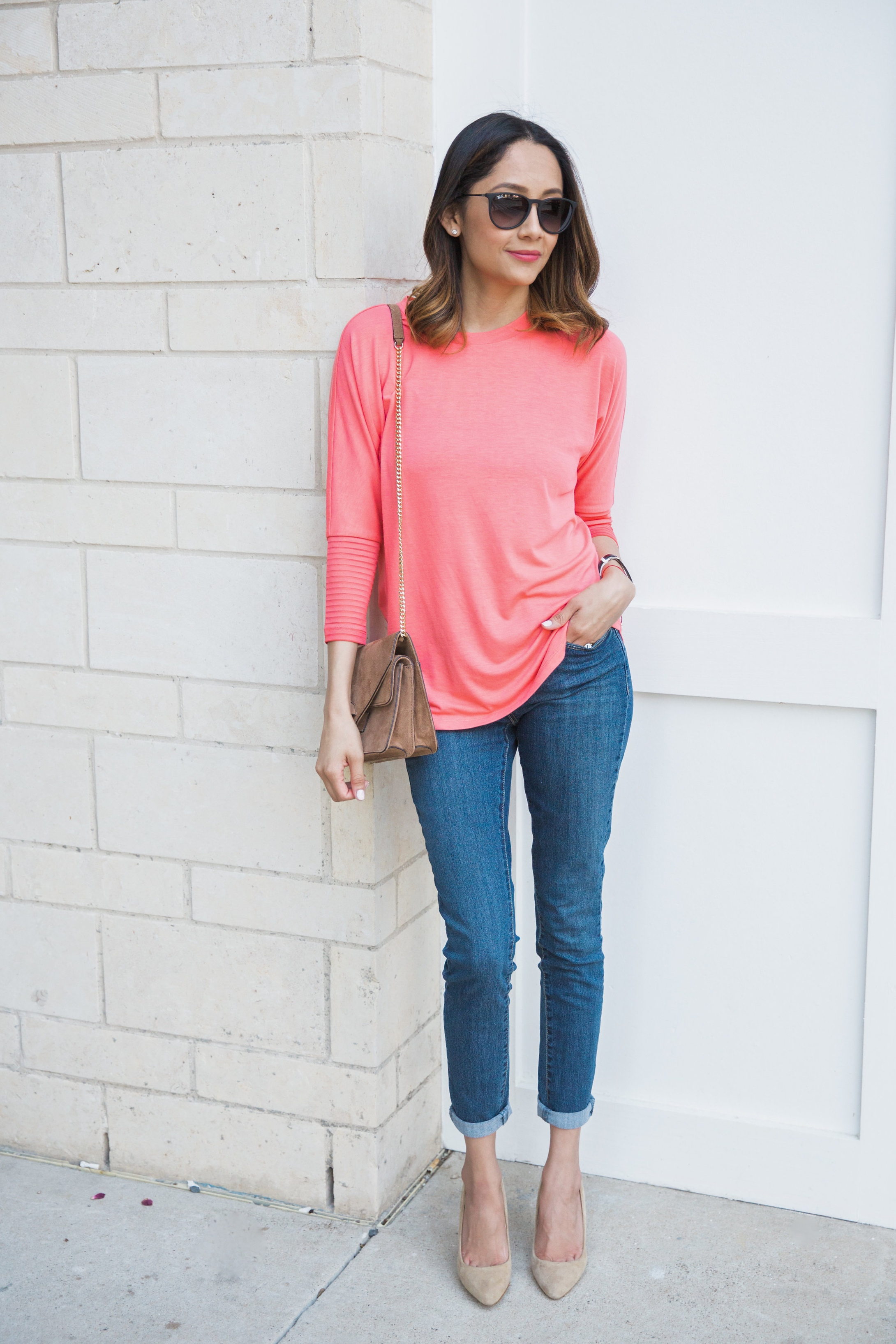 Lifestyle blogger Lilly Beltran of Daily Craving wearing cuffed mom jeans nude heels and a basic long sleeve tee