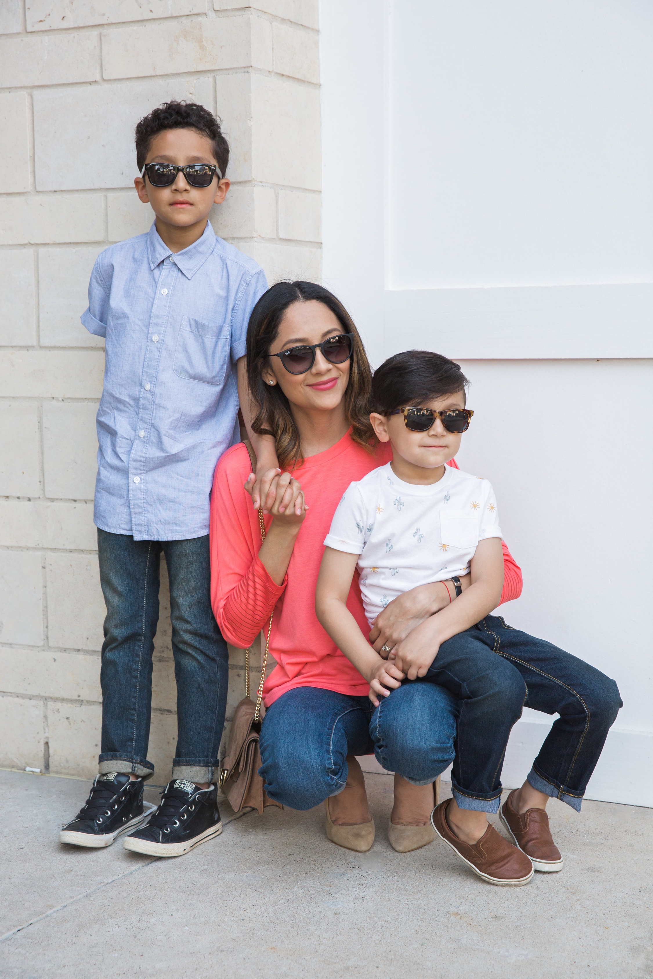 Lilly Beltran of Daily Craving blog with her two sons Evan and Mason  in a casual look with mom jeans and a basic tee