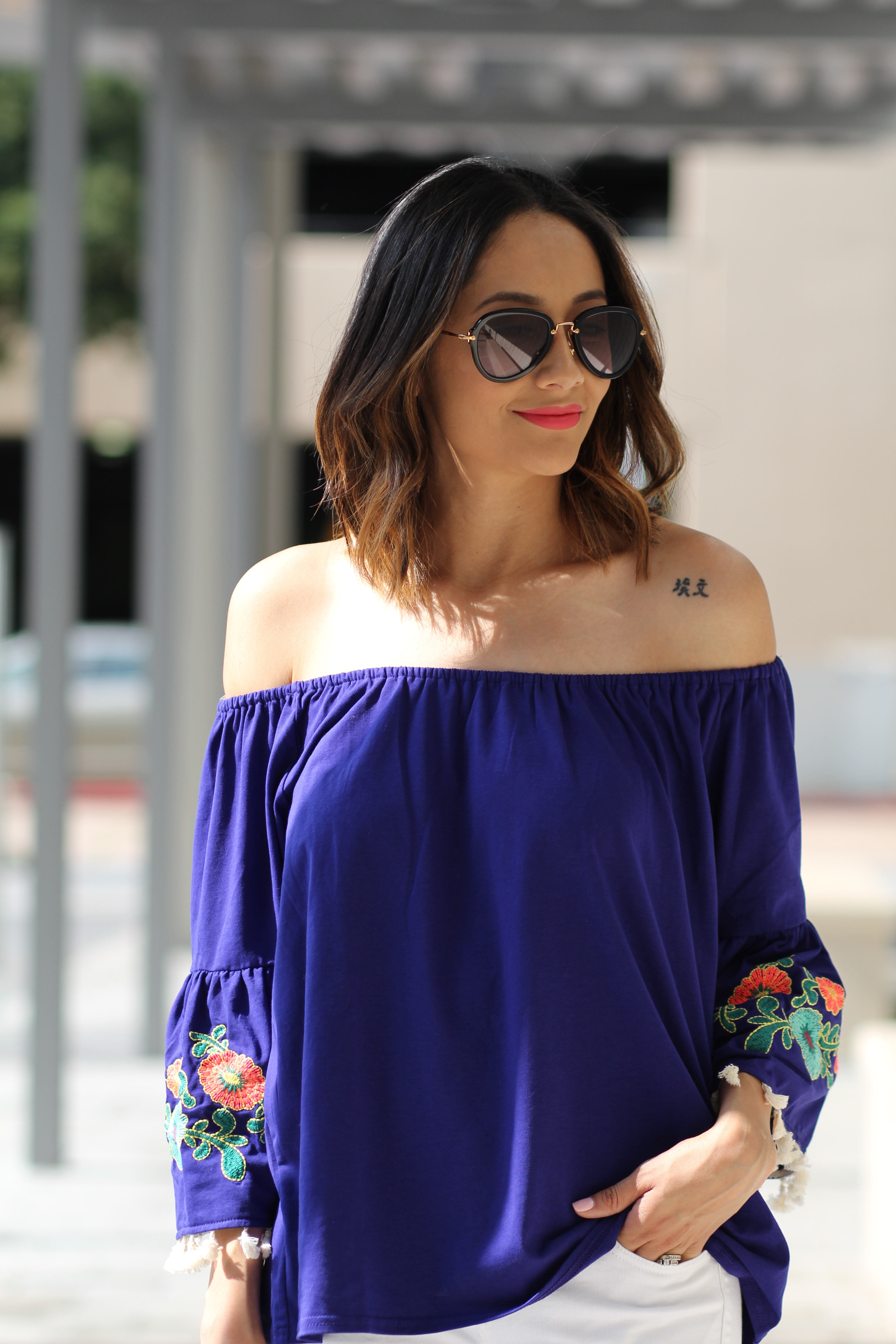 embroidered bell sleeves off the shoulder top